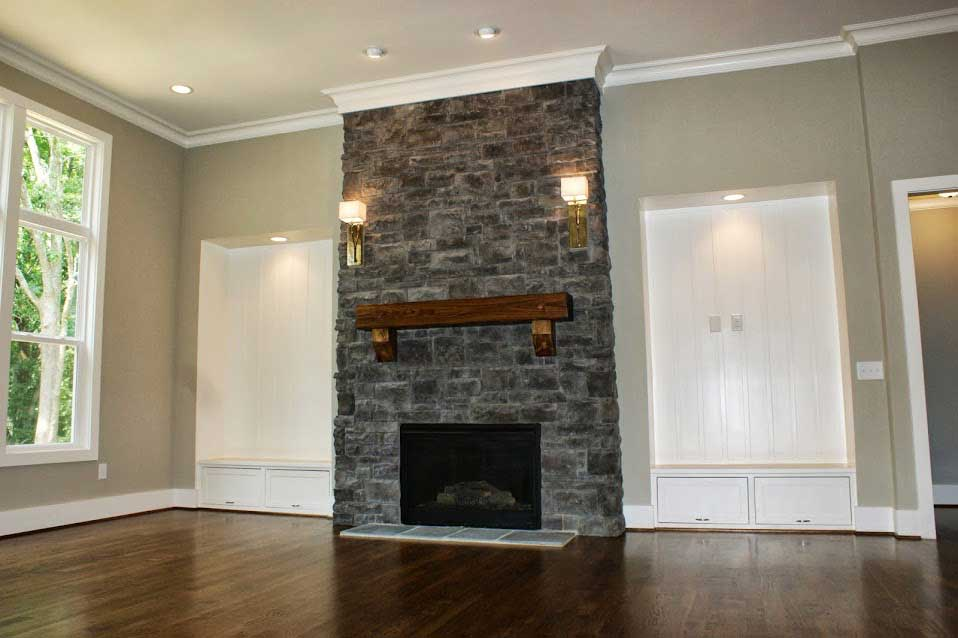 Rustic wood mantel shown with cedar corbel application