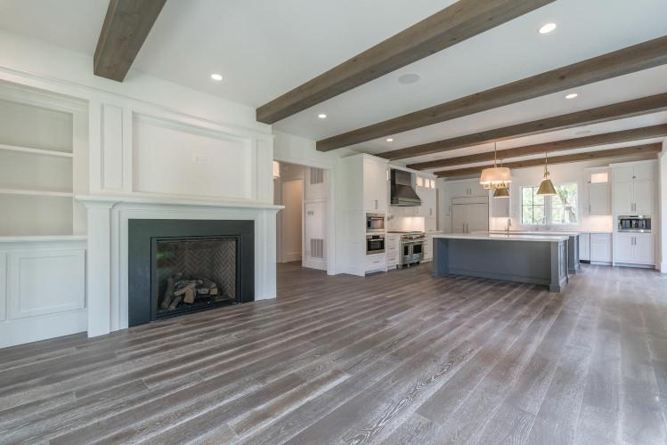 Elegant cedar ceiling beams add a modern yet warm feel .