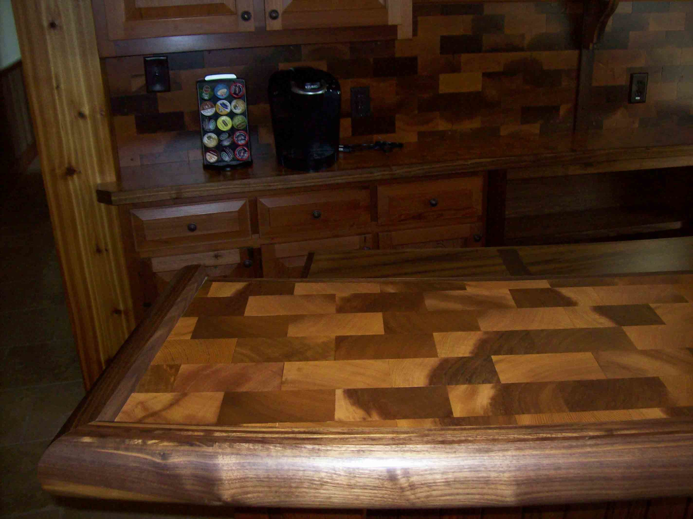 The wood tile countertop is a one of a kind piece.