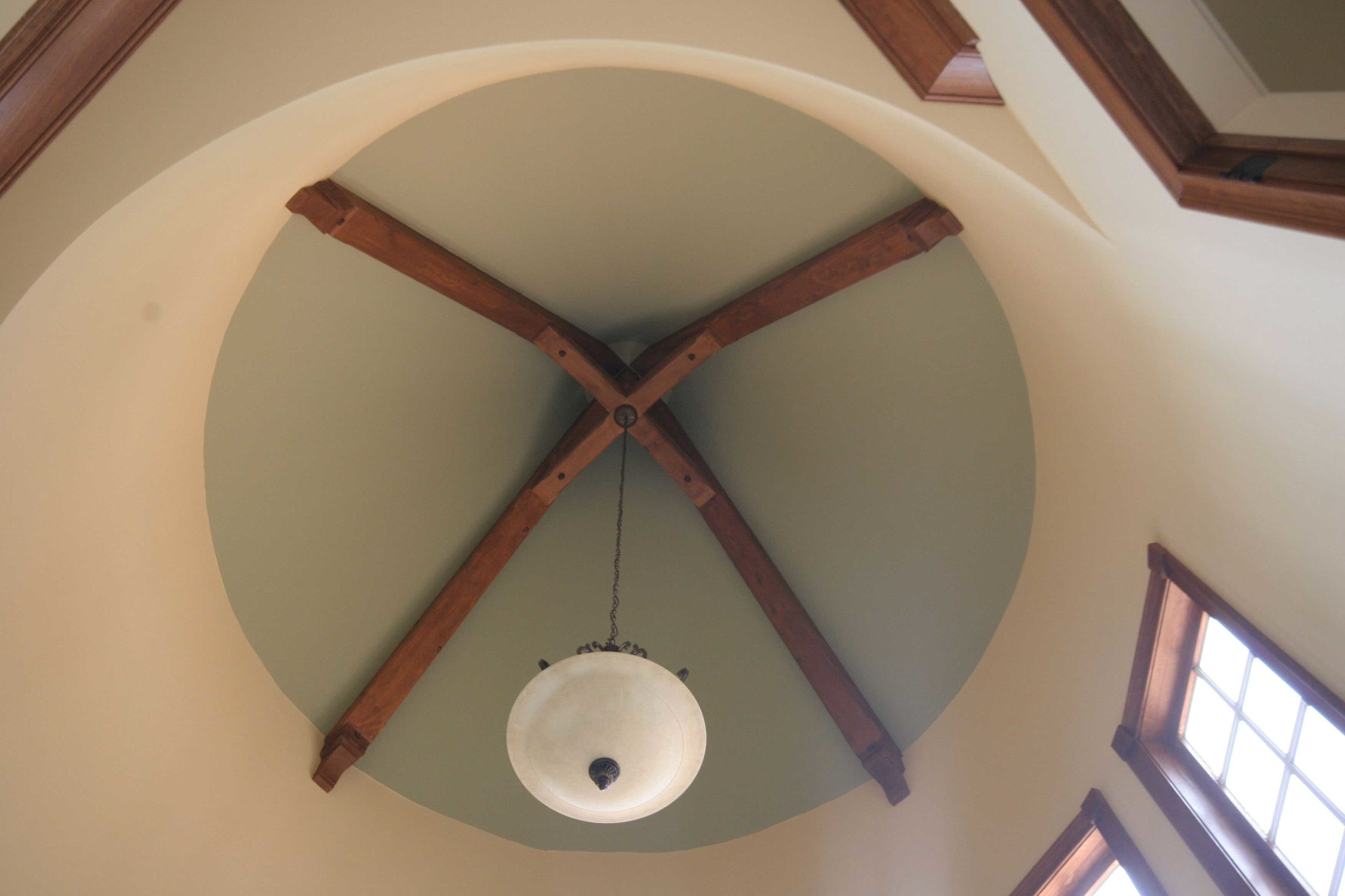 The wood beams, wood braces, and wood corbels in this feature accent this turret ceiling very nicely.