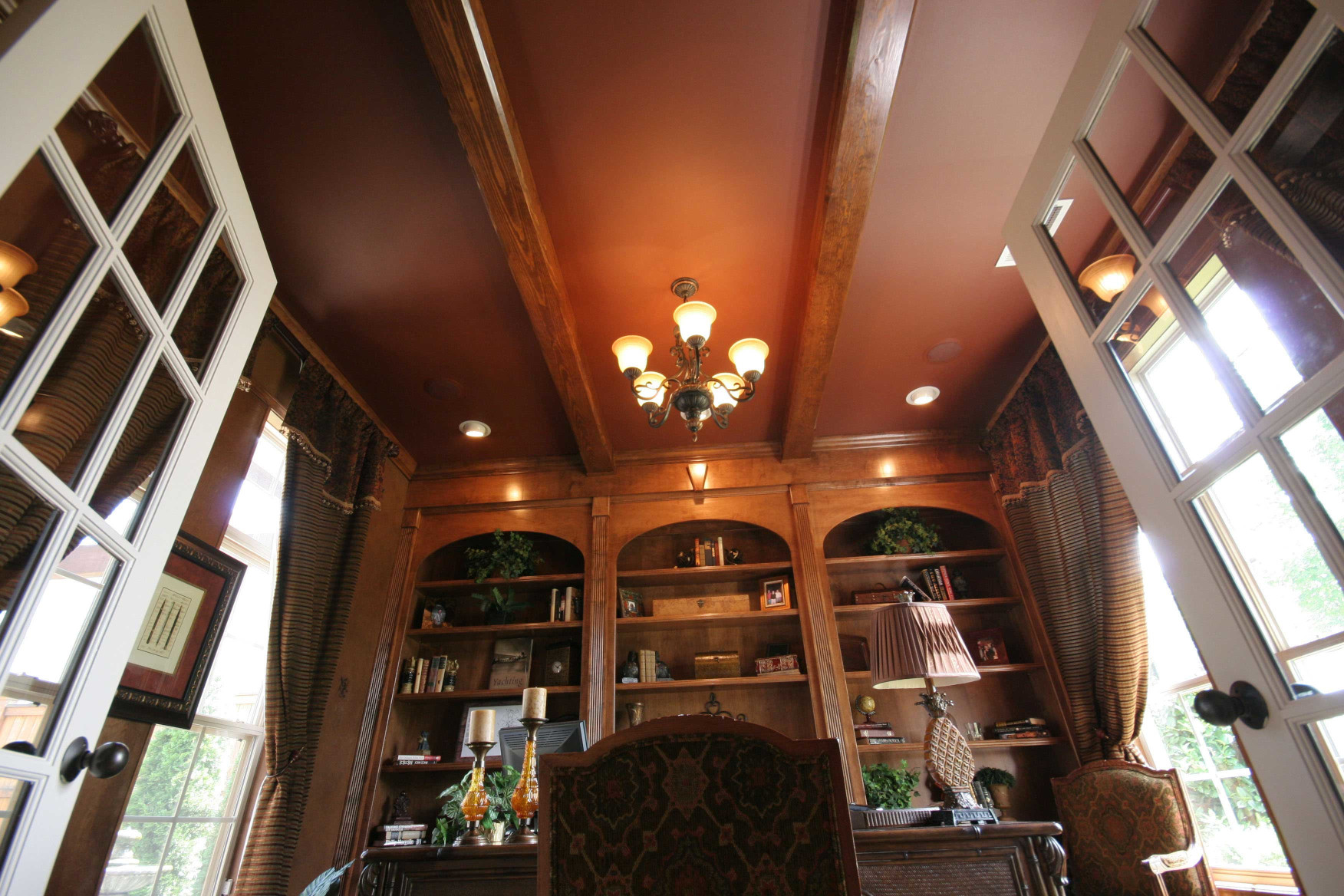 The wood beams in this study add elegance to this at home office space.