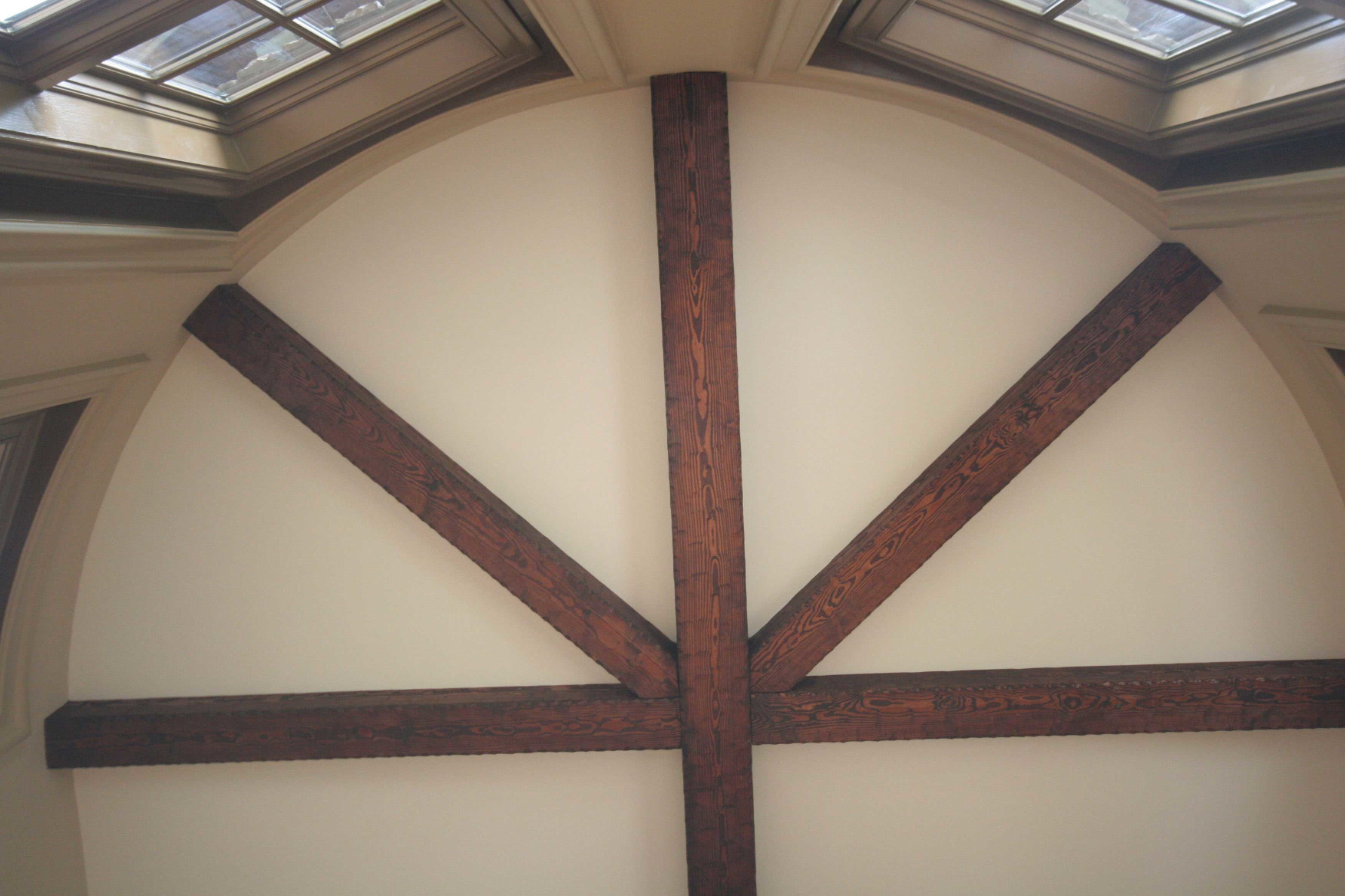 These wood box beams are an excellent custom design for this ceiling.