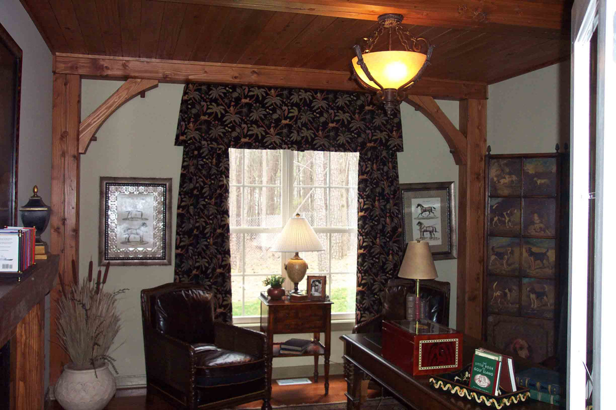 The wood beams in this study add a rustic feel to this at home office space.