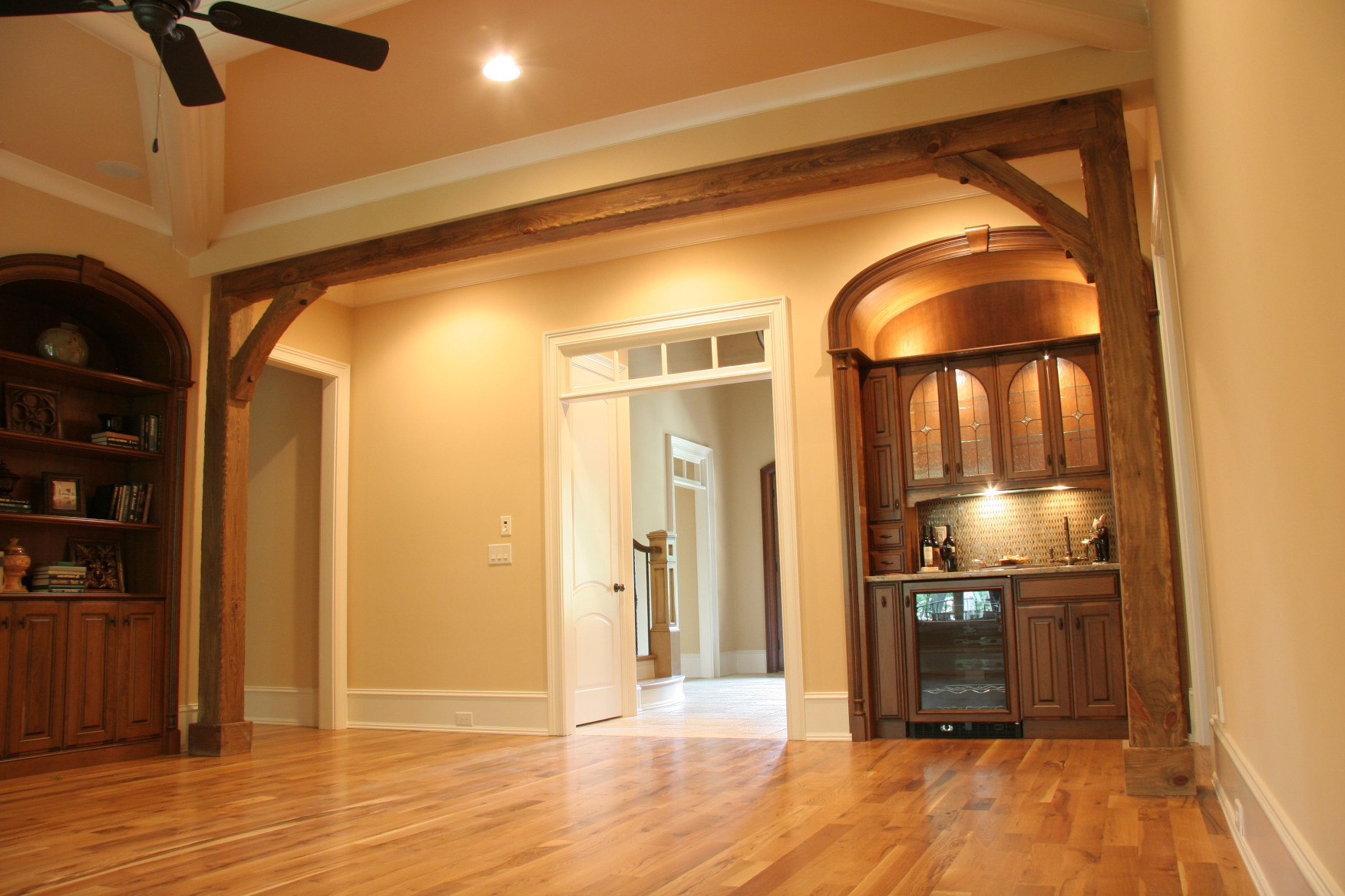These wood beams, wood posts ,and wood braces are a great space definer in this great room.