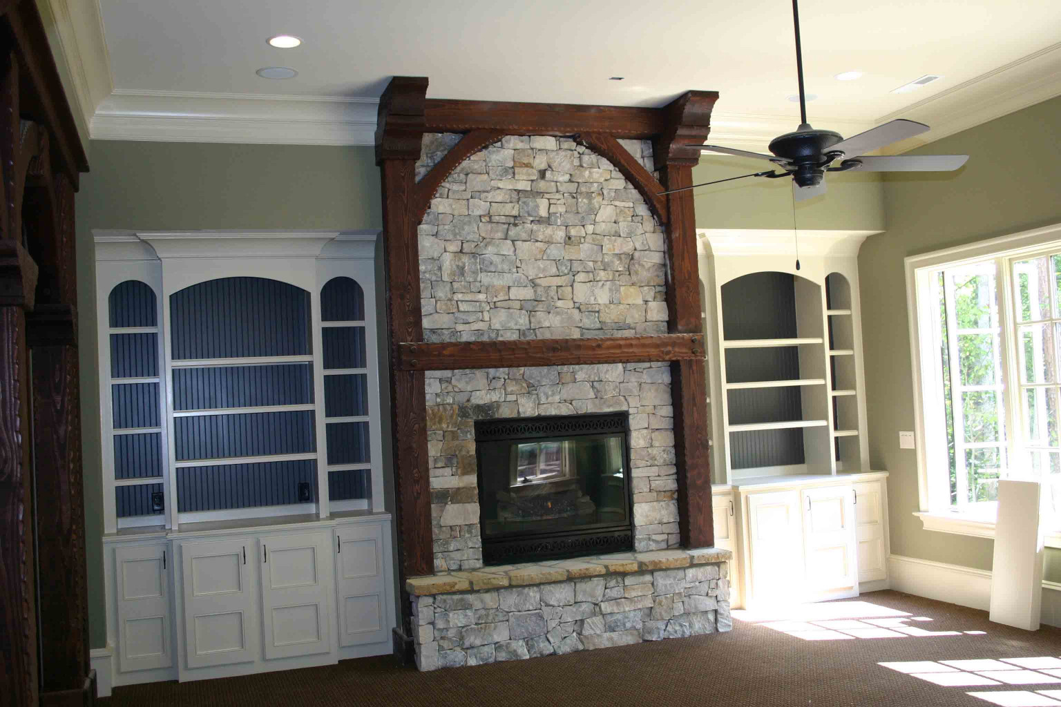 The custom design of this wood mantle with legs and wood braces and beam ends, was exaclty what this customer envisioned.