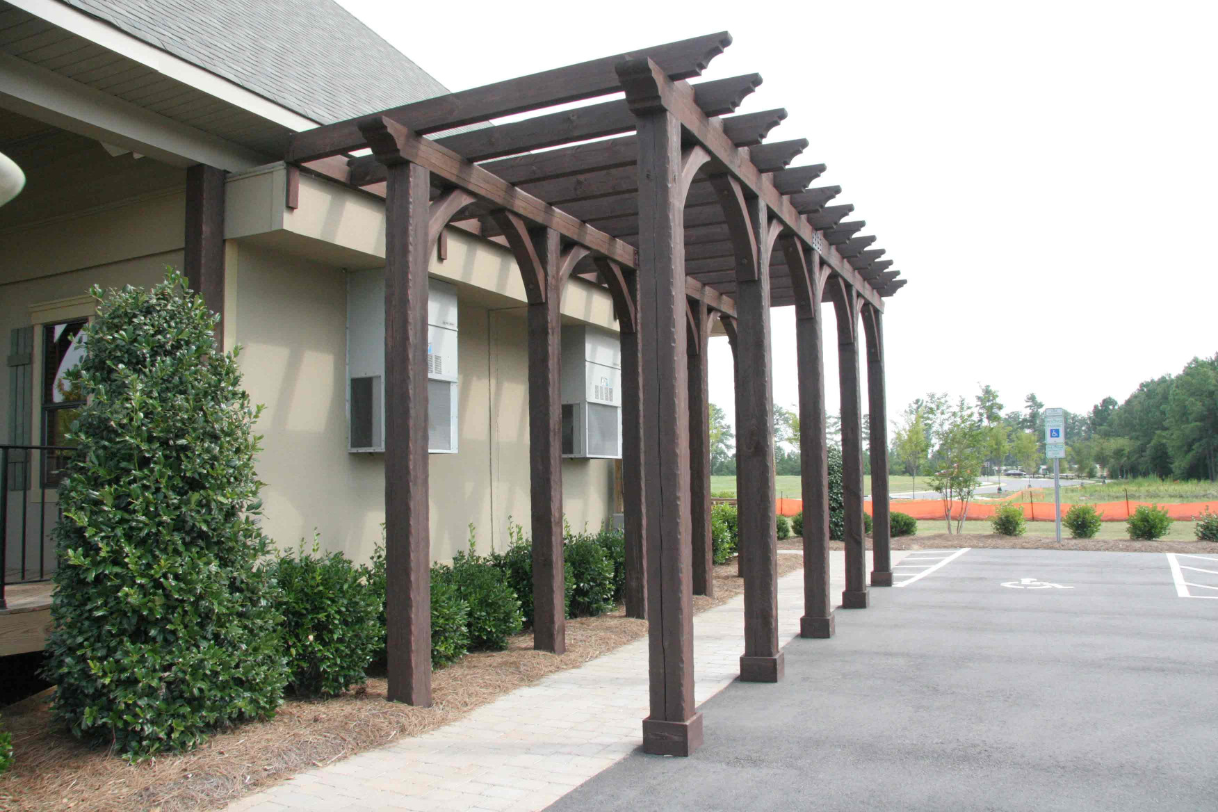 This custom wood arbor feature is a great way to add to a walkway.
