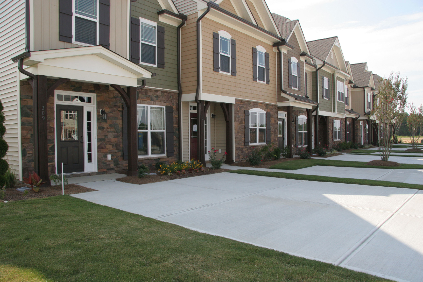 The wood braces and posts on these townhomes prove that our products are a fit for every house!