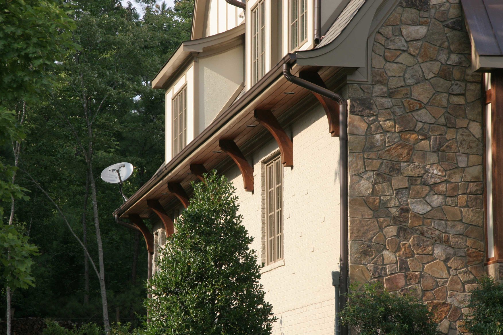 Wood braces are a detail that completes the exterior of this home.
