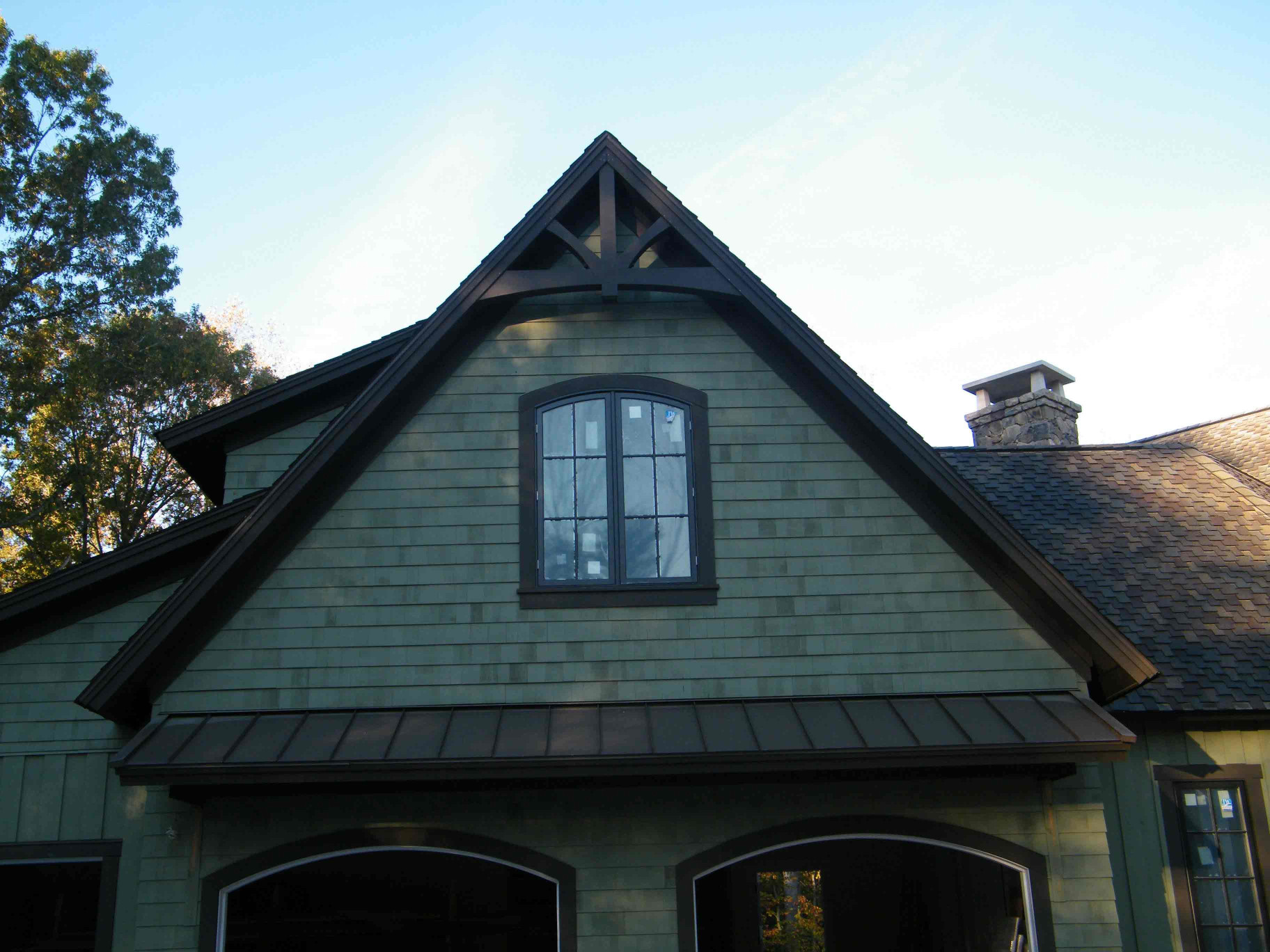 This wood gable bracket is a great way to add curb appeal to a home.