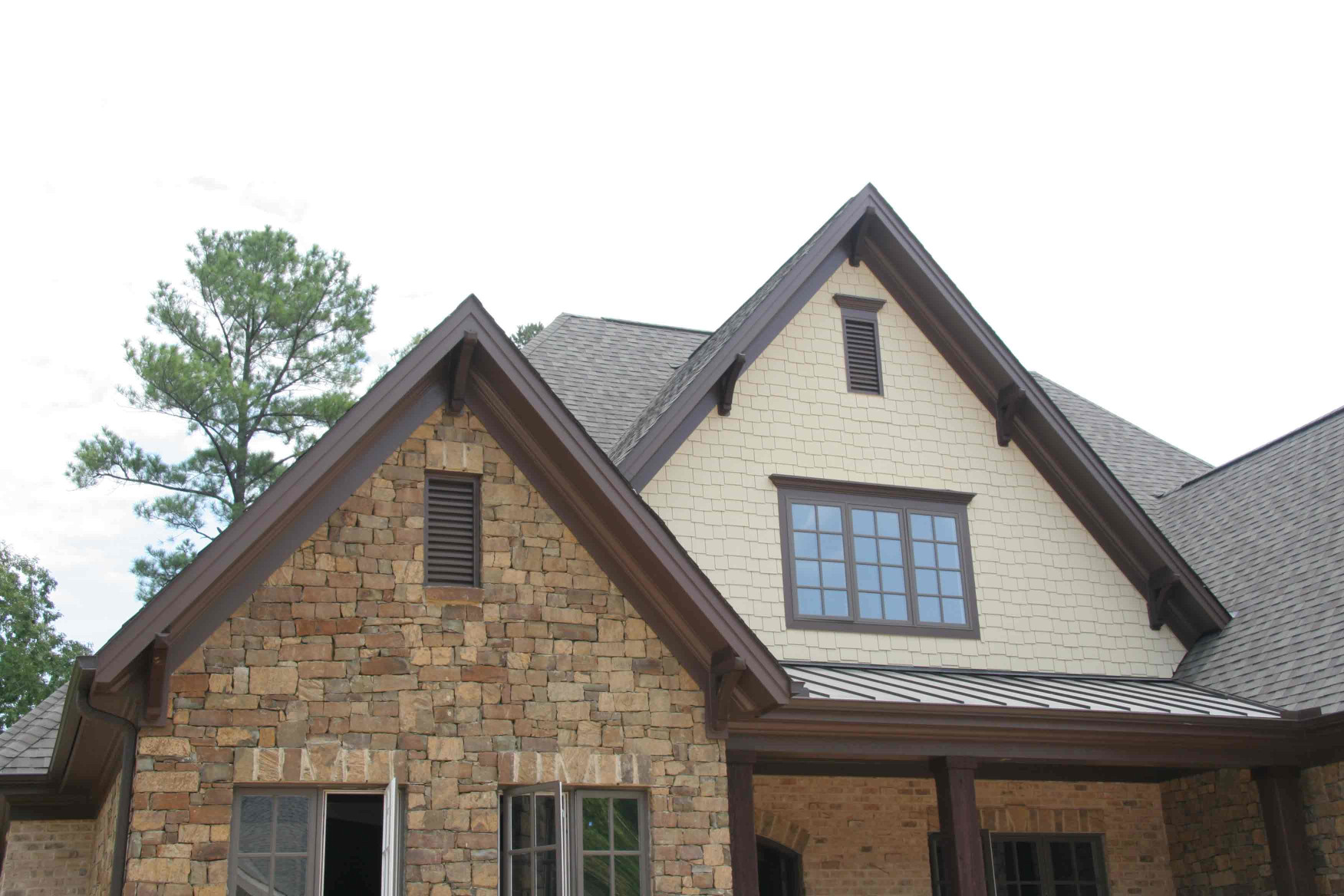 These wood brackets are a great way to add detail to overhangs.