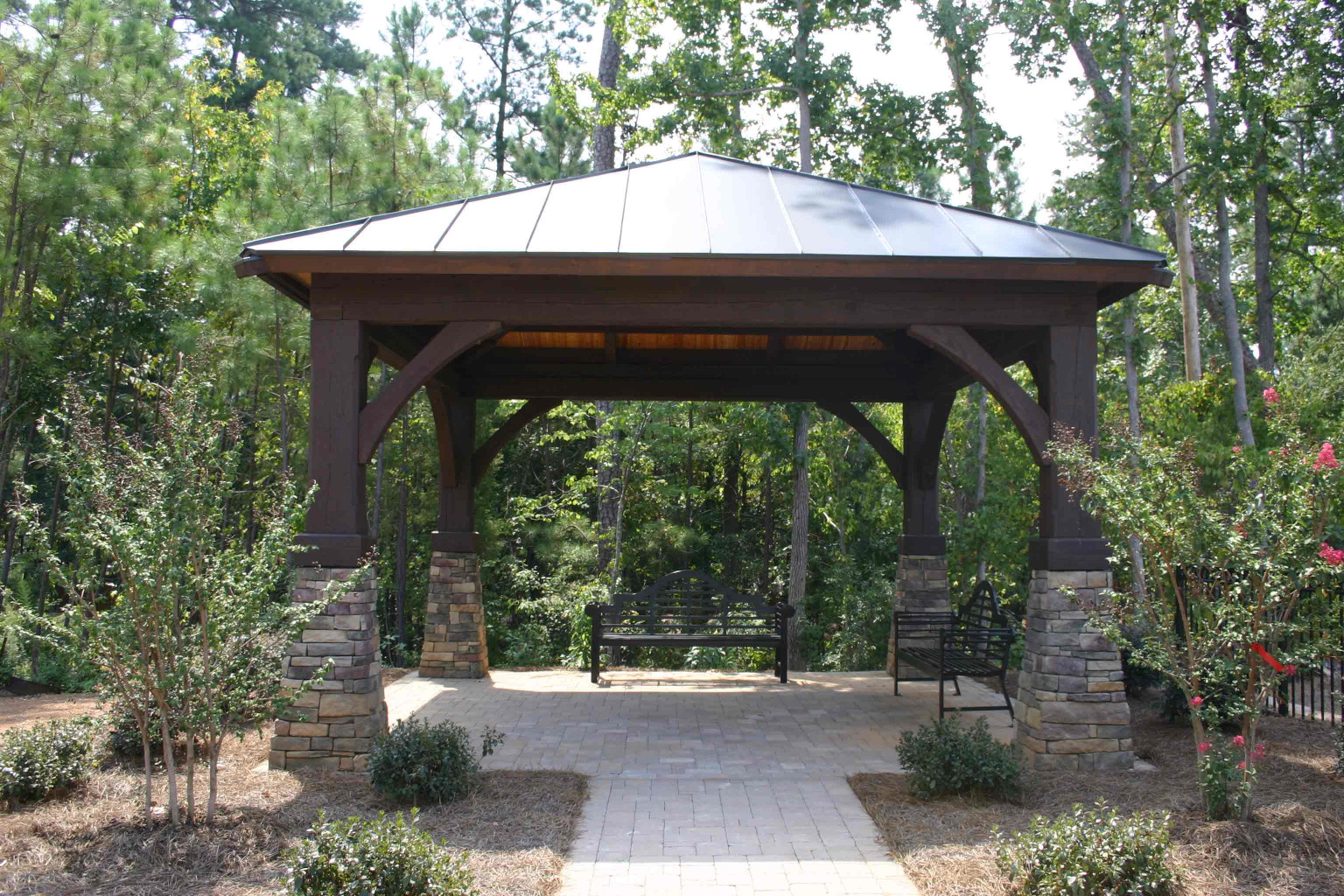 This Timber Frame Gazebo Kit with wood beams, wood posts, and wood braces is a perfect way to add shade.