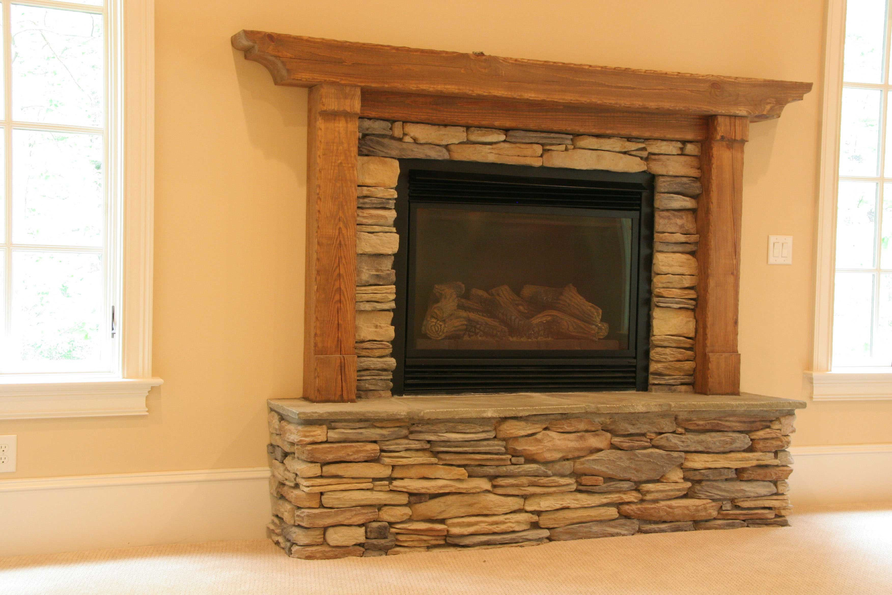 This wood mantle with legs was custom designed for this home.