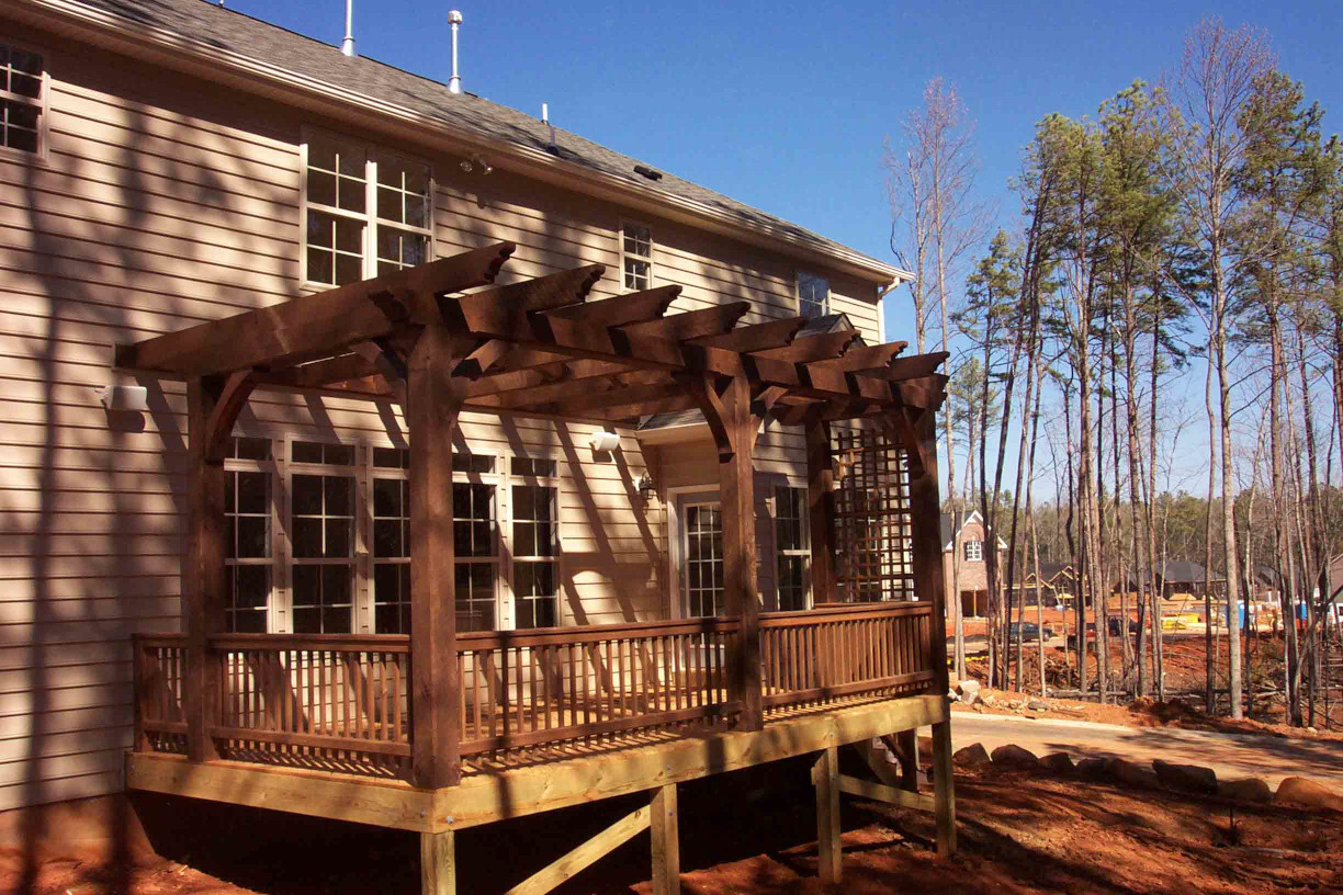 This wood pergola is a great  way to add to a deck.
