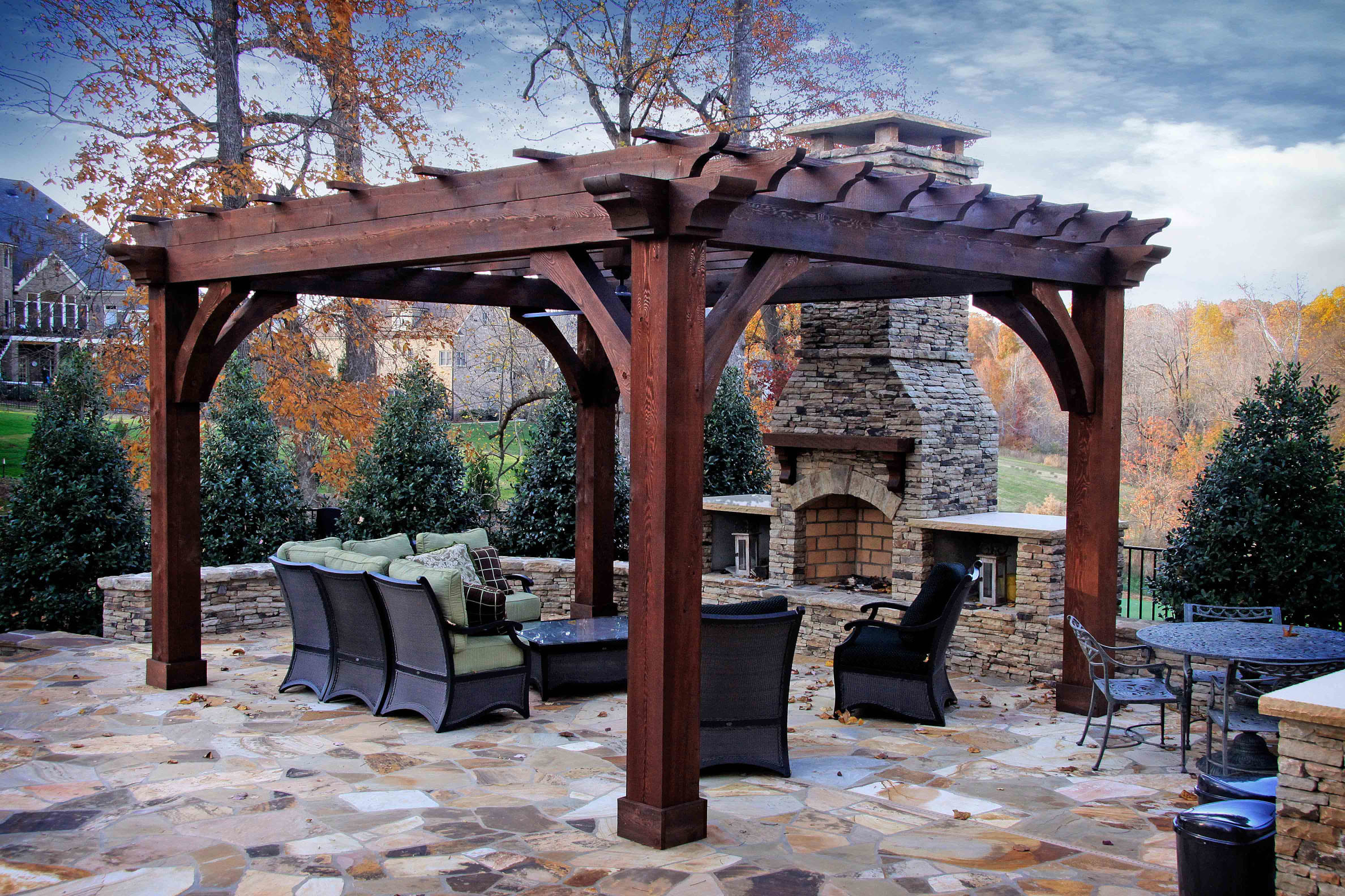 This wood pergola is a great way to add shade and appeal to this pool.