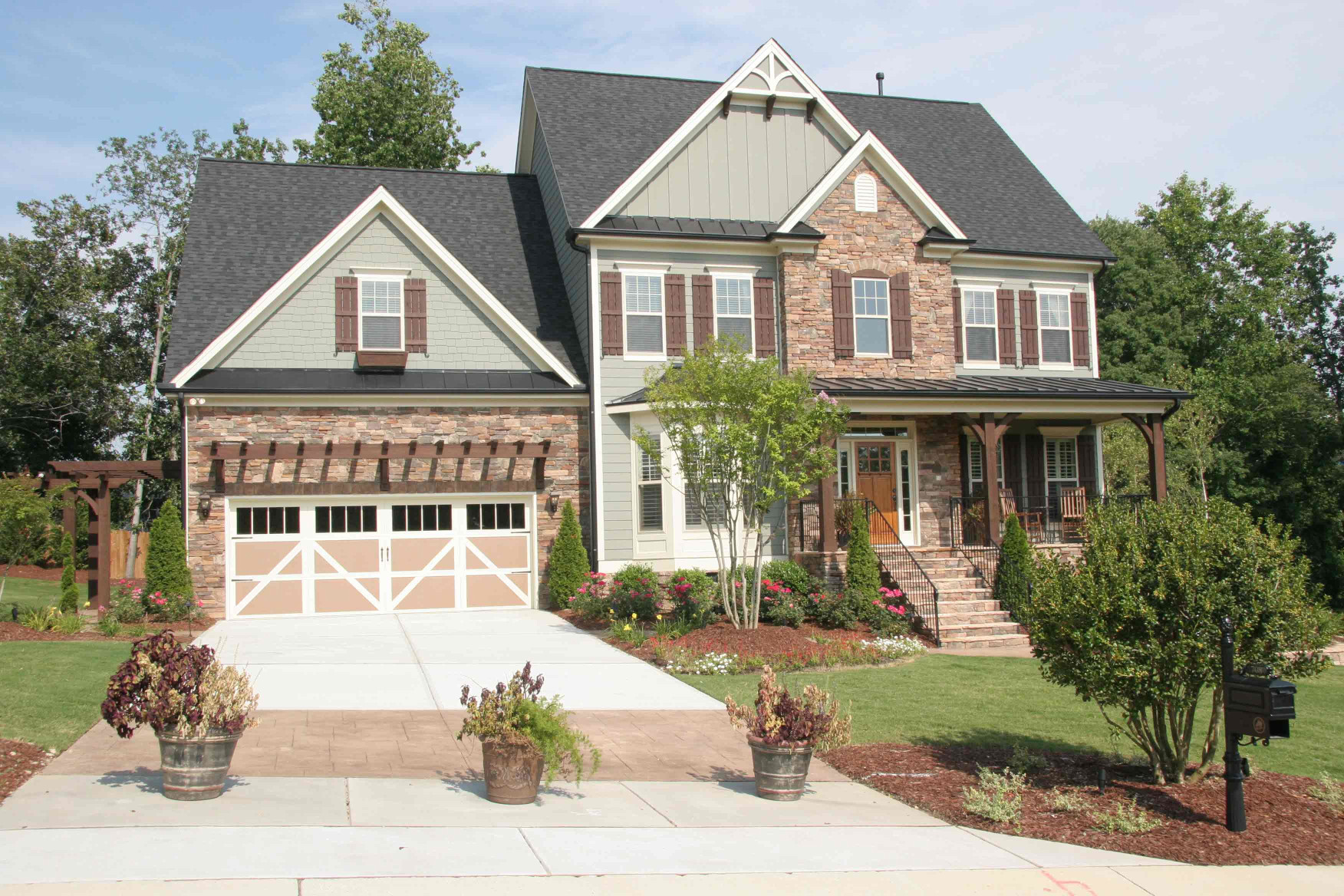 This home features our wood posts, wood braces, wood shutters, wood trellis  and wood arbors.