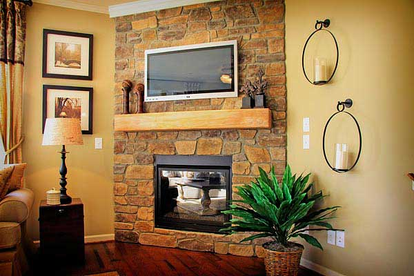 Rustic mantel in stone application