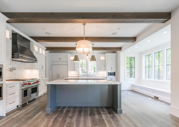 The wood beams in this kitchen add a modern yet warm feel .