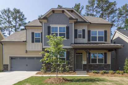 These wood post wraps, wood braces, and beam ends complete the look of this home.