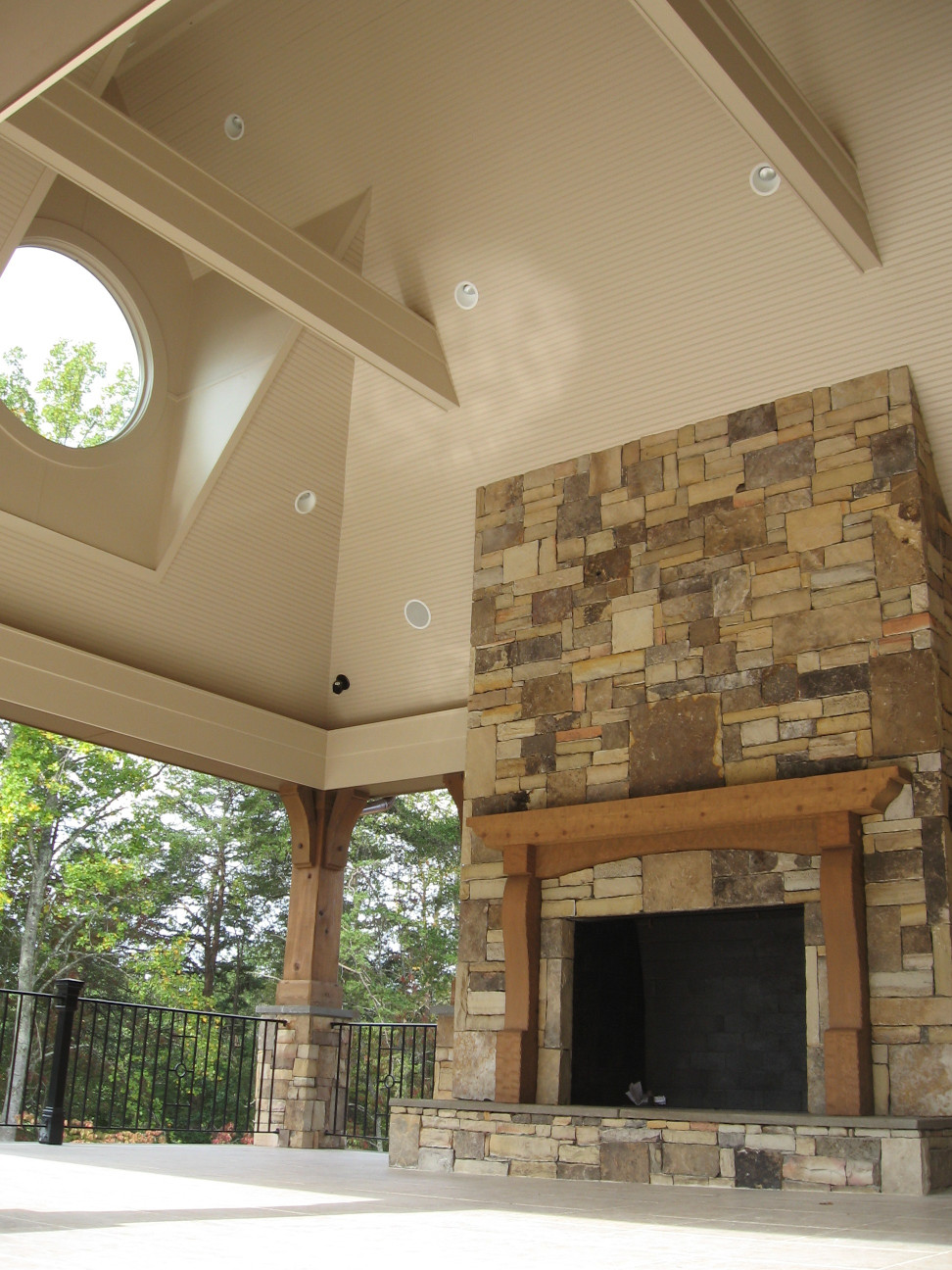 This Wood Mantel with legs is just the right touch on this porch fireplace.