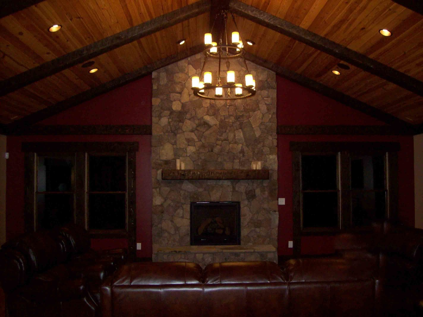 The wood beams and wood mantle add a rustic element to this great room.