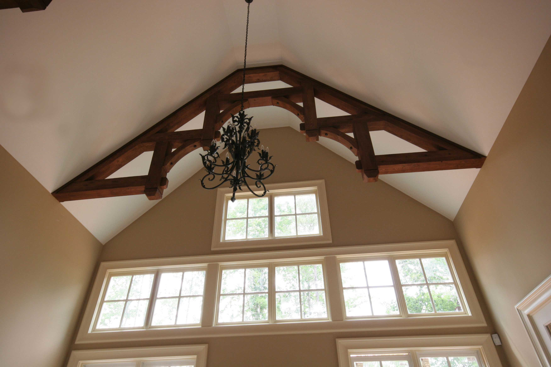 The wood braces and wood beams constructing this wood truss are a elegant accent in this Great Room.