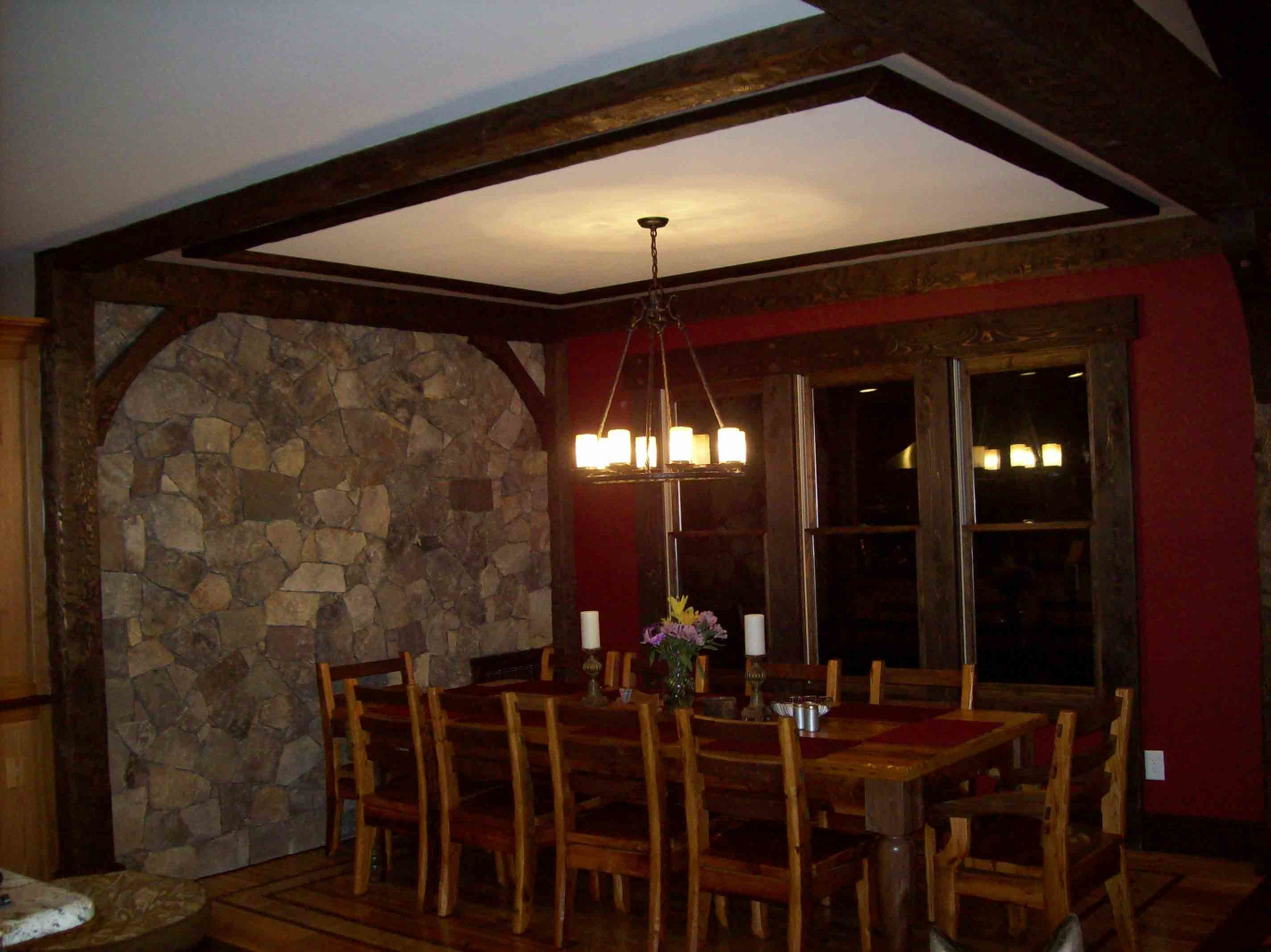 The wood beams, wood posts, wood braces ,and window trim are a custom design for this dining area.