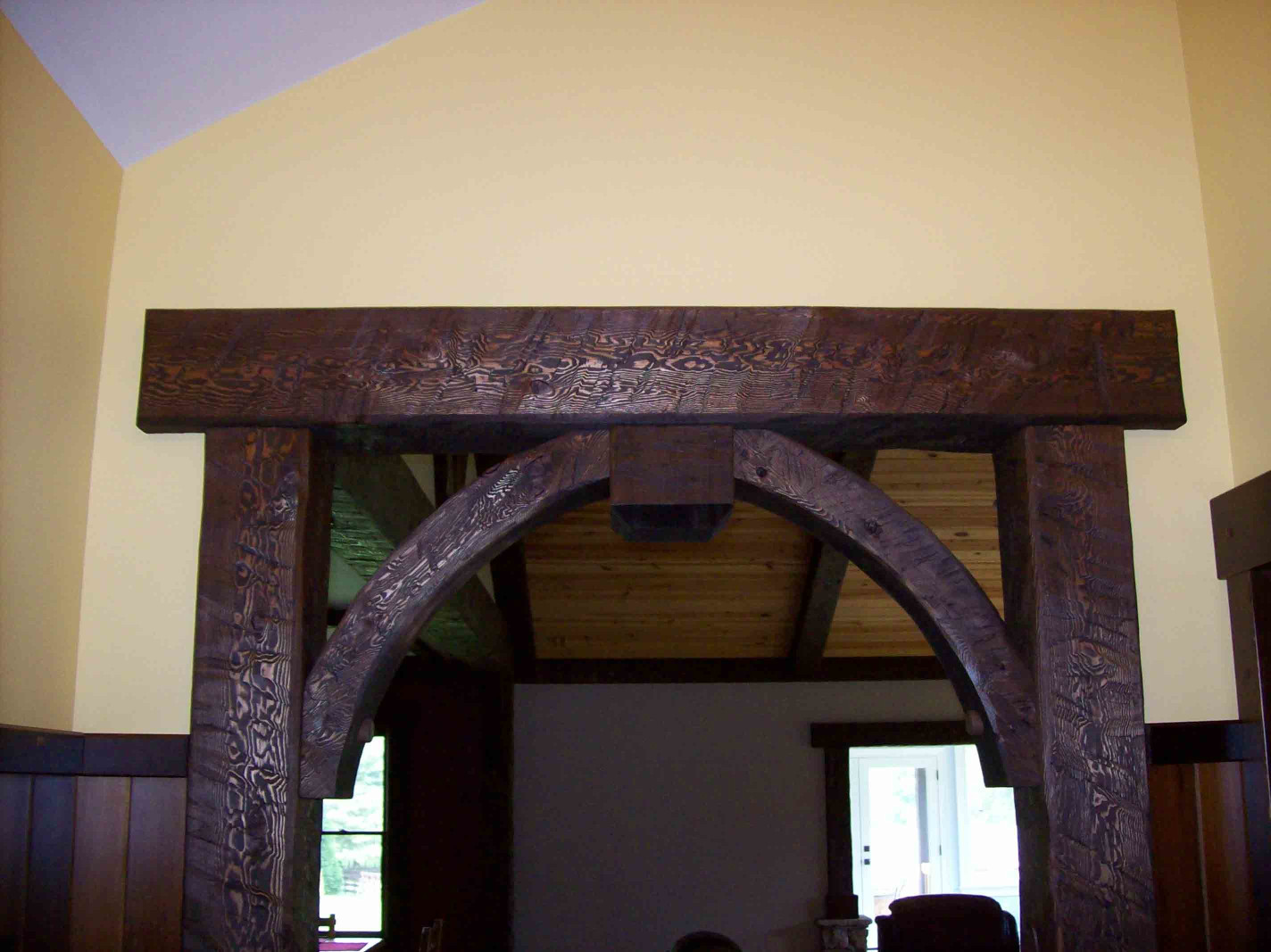 The wood beams, wood posts, and wood braces add elegance to this entry.