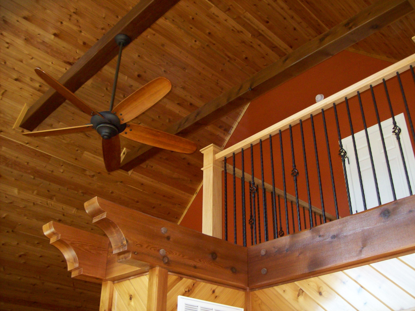 Custom wood beams in this home add curb appeal and fit design needs.