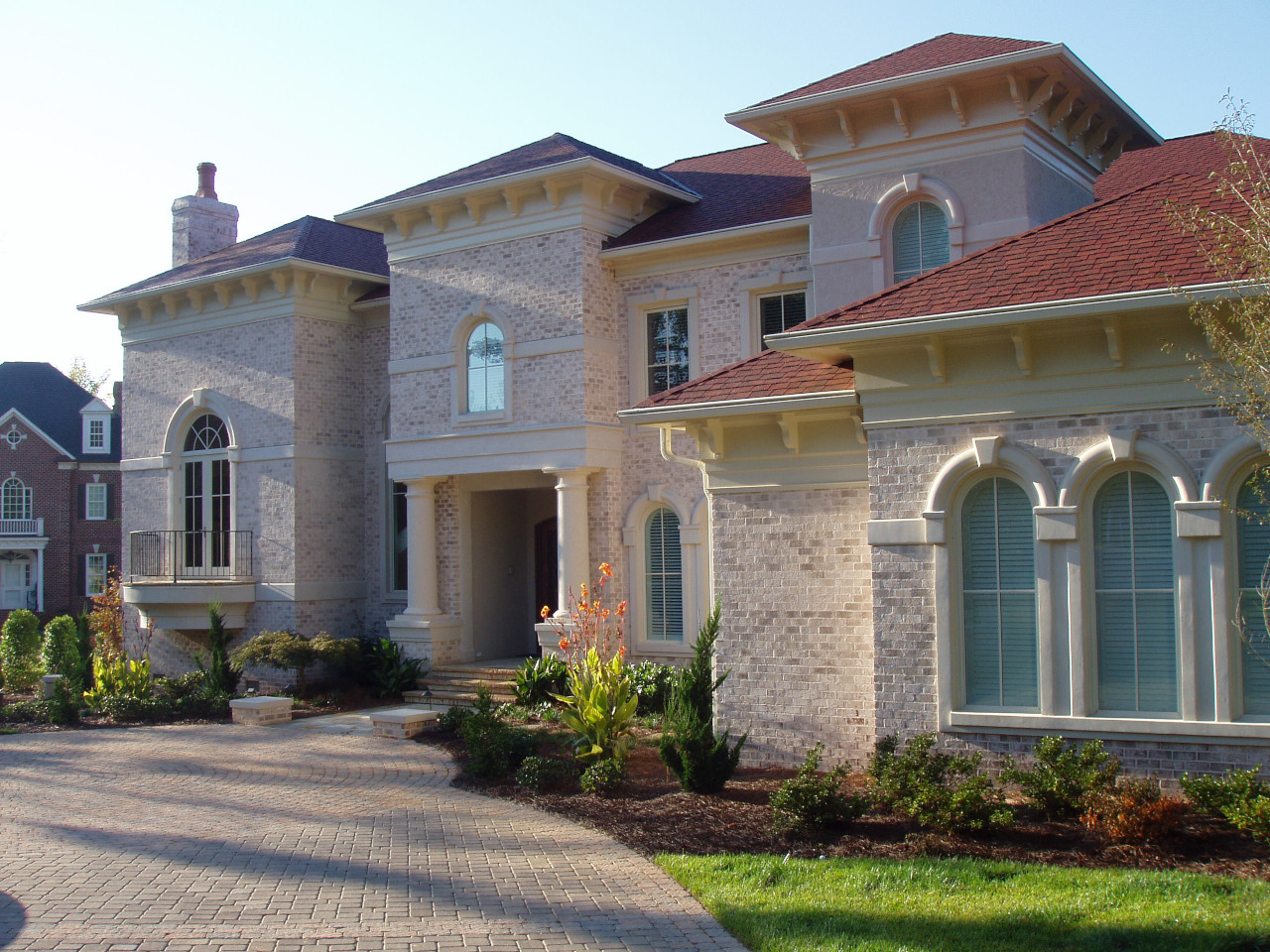These custom wood braces complete the style of this Mediterranian inspired home.