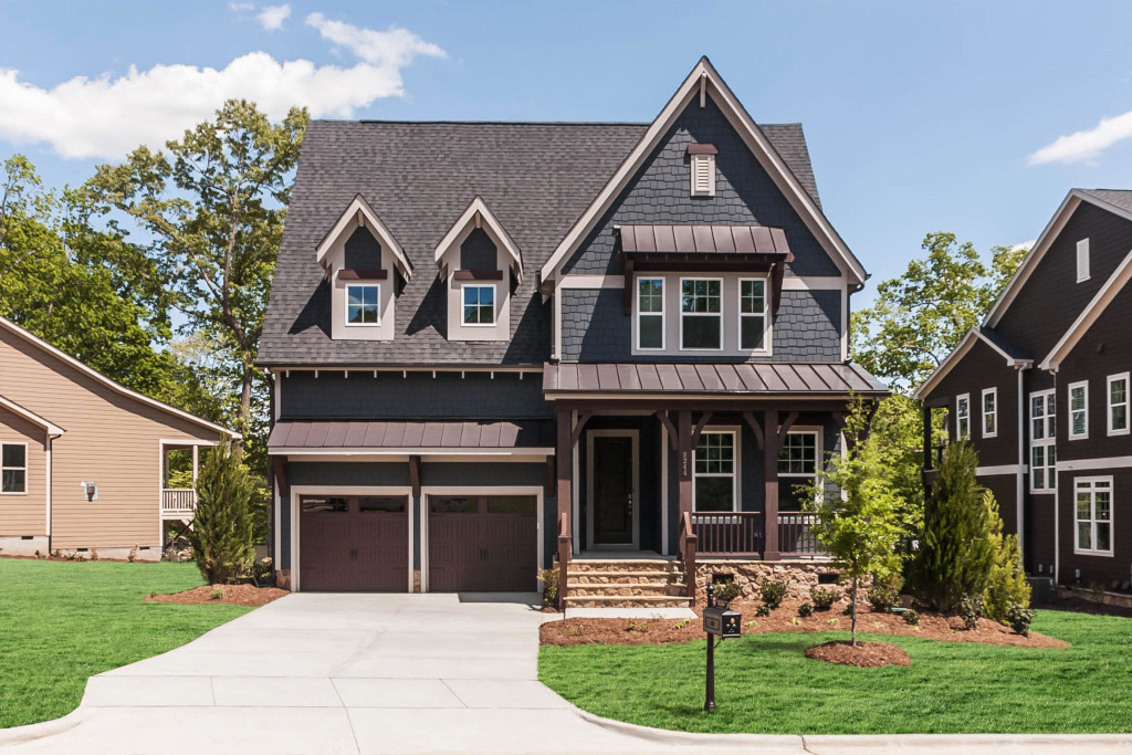 Wood brackets, wood braces, posts, and headers complete the look of this Craftsman style home.