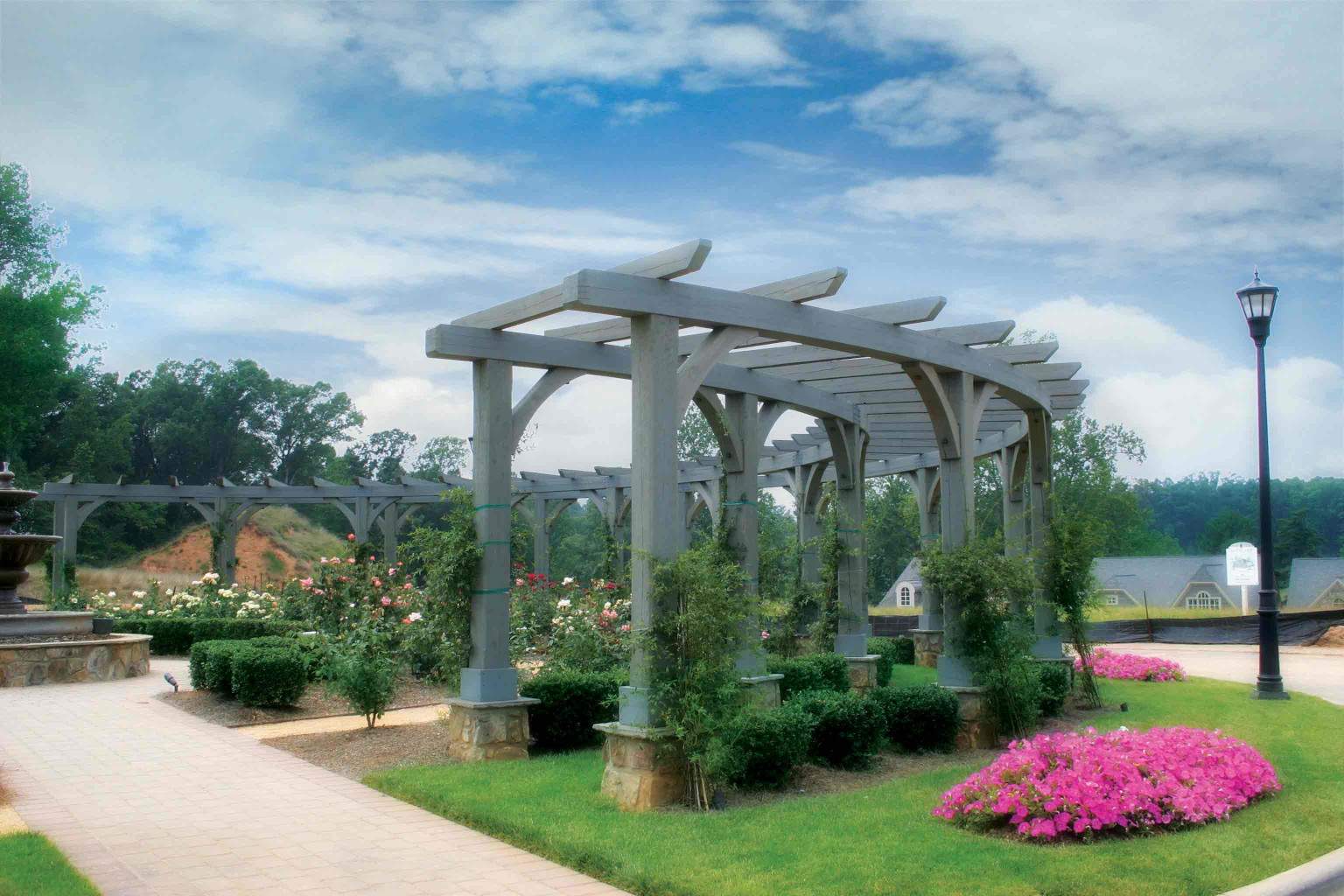 This custom designed wood arbor feature is a great addition to this garden.
