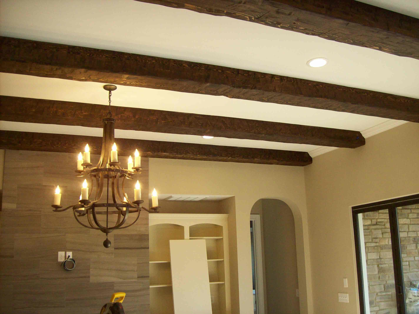 The wood beams on this ceiling give an historic feel to this home.
