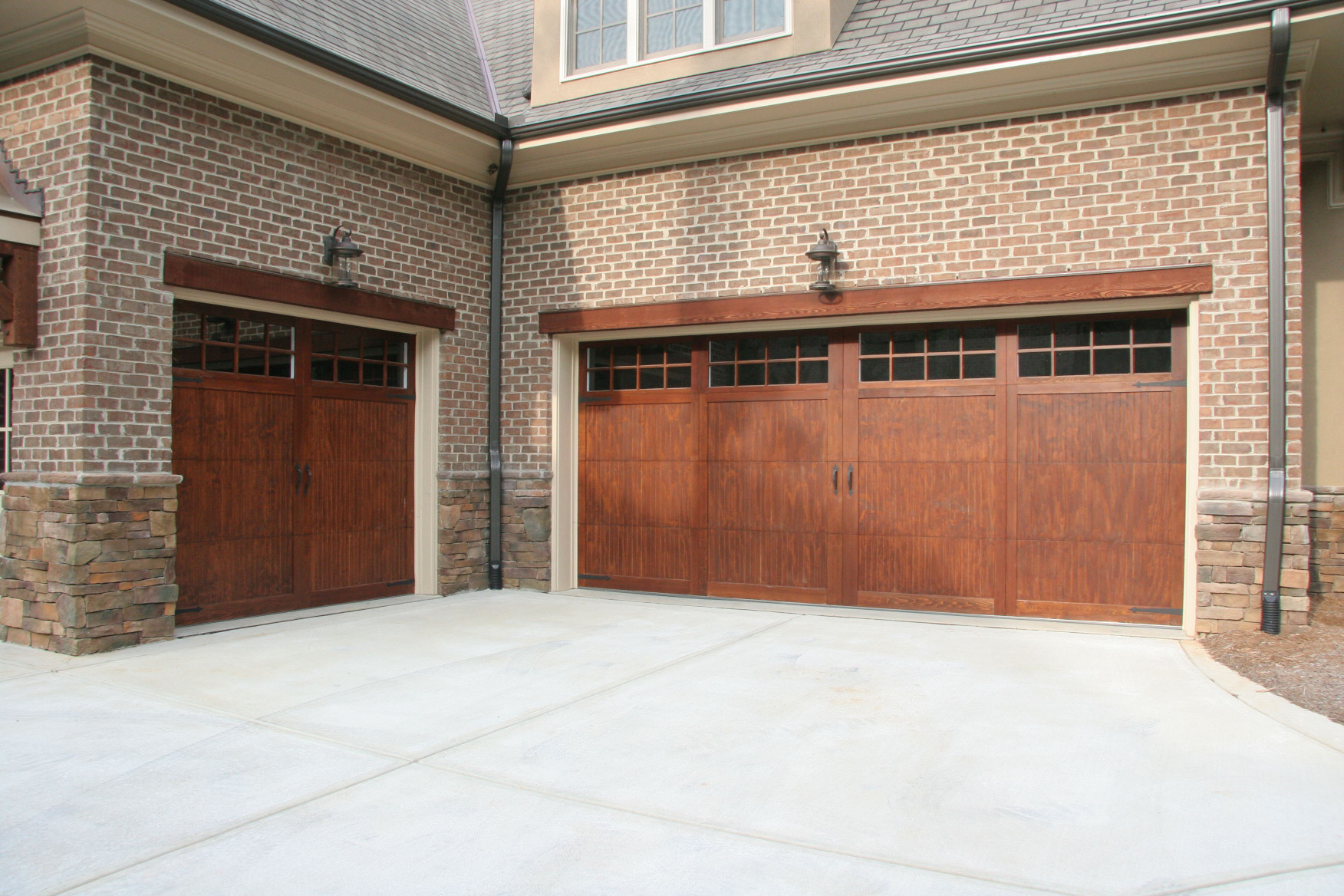 Headers add the detail and elegance to create an appealing addition to this garage entry.