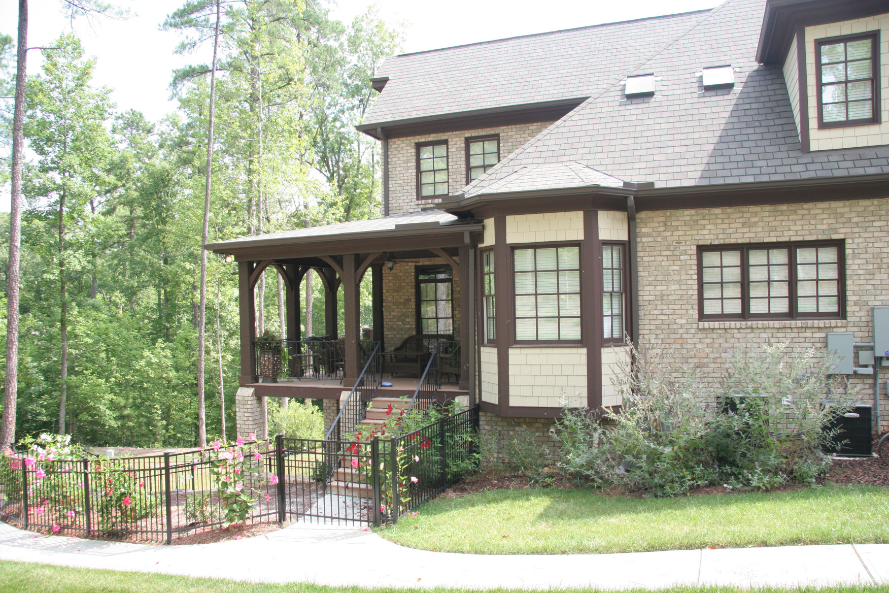 This Post Kit  and wood brackets add Old World Charm to this wrap around porch.