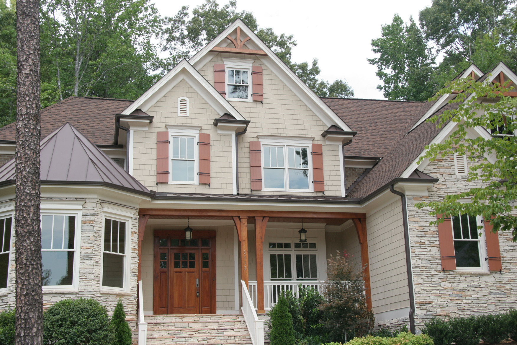 The wood posts, wood braces, and wood gable brackets on this house are western red cedar.