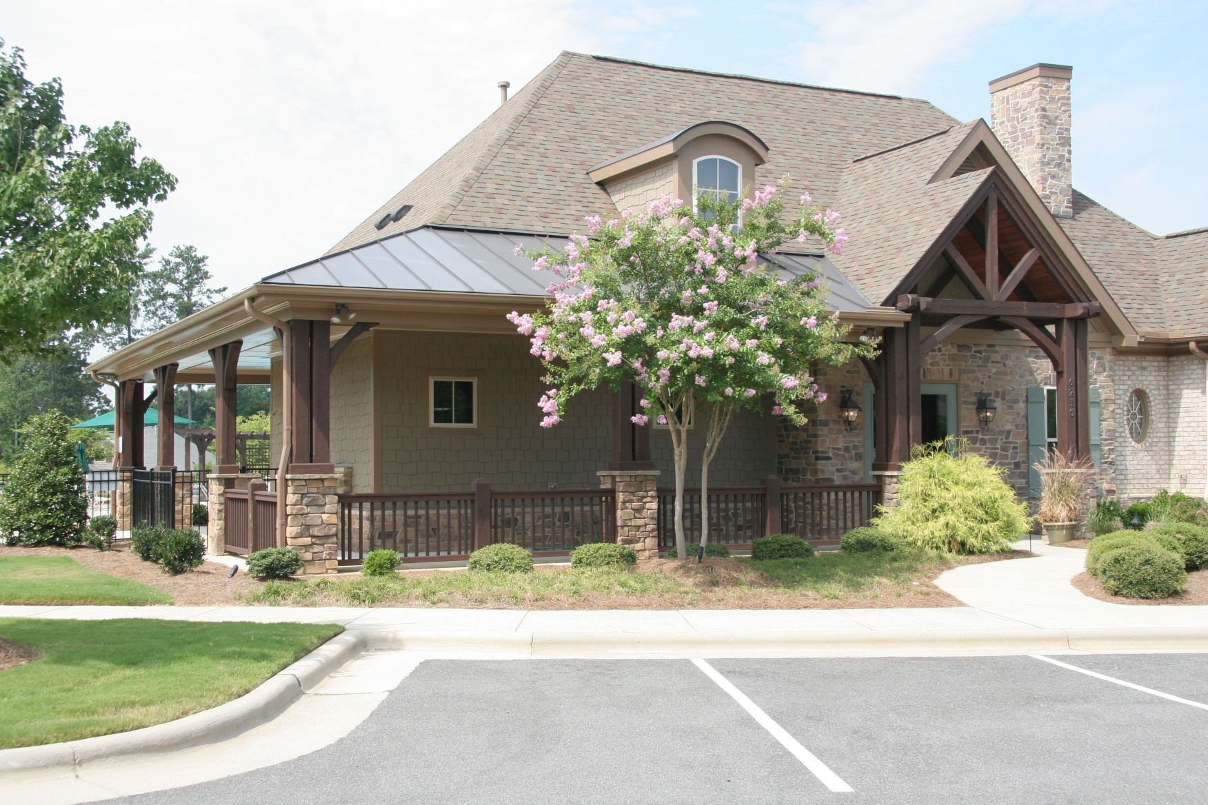 The wood braces, wood posts, wood gable, and wood railing add to the elegance of this clubhouse.