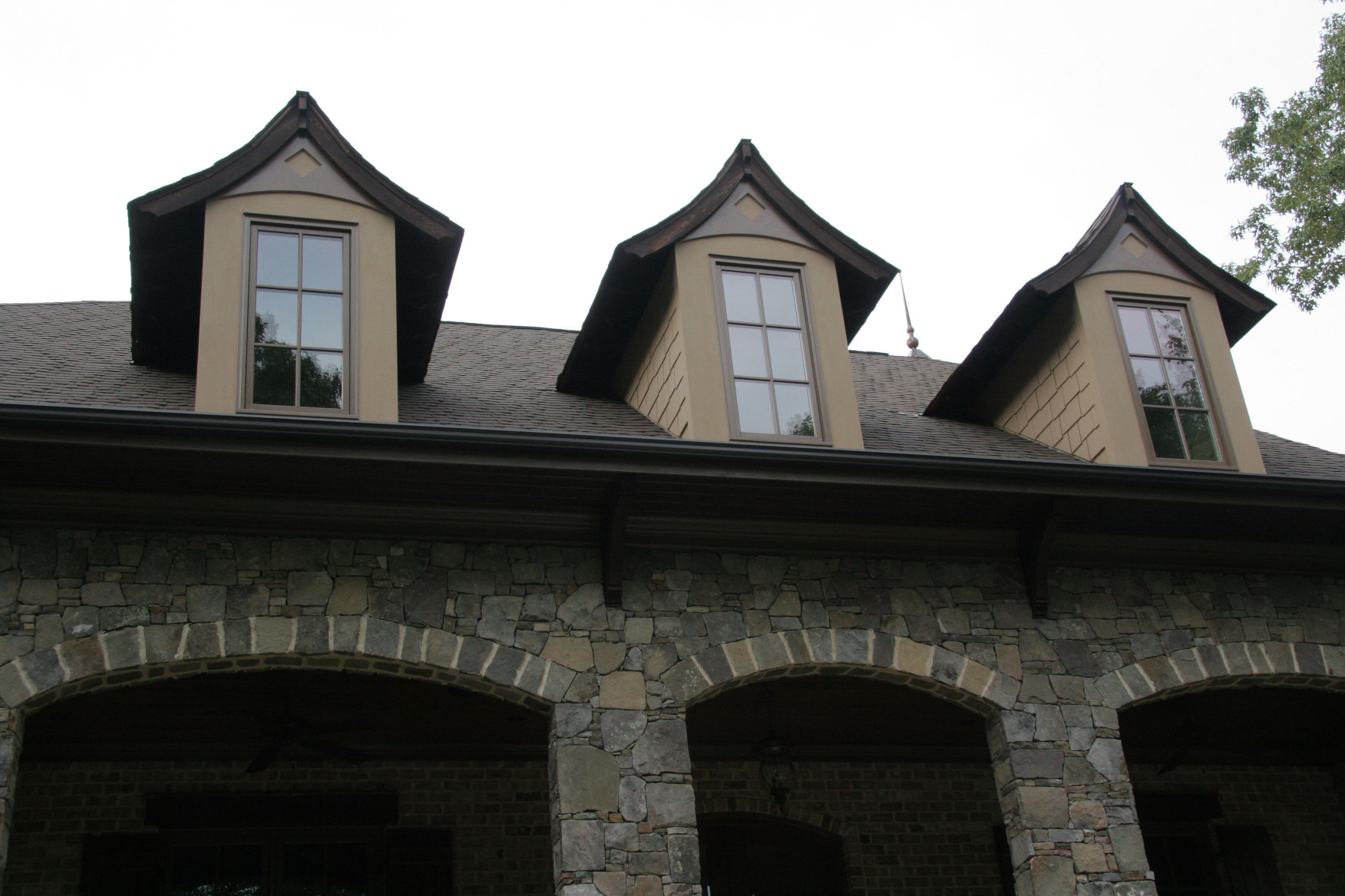 Our wood brackets and rafters can be custom designed to fit your needs!