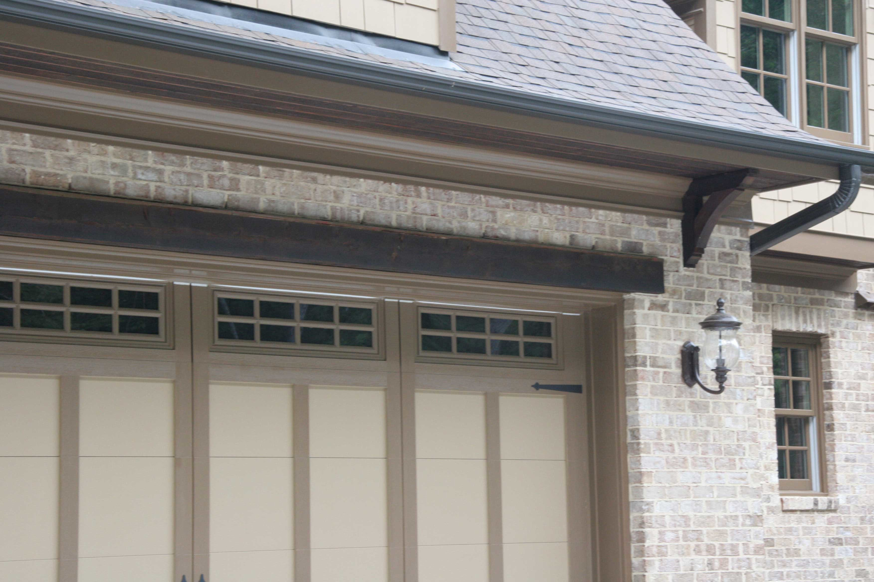 Wood brackets and headers add to the look of this garage entry.
