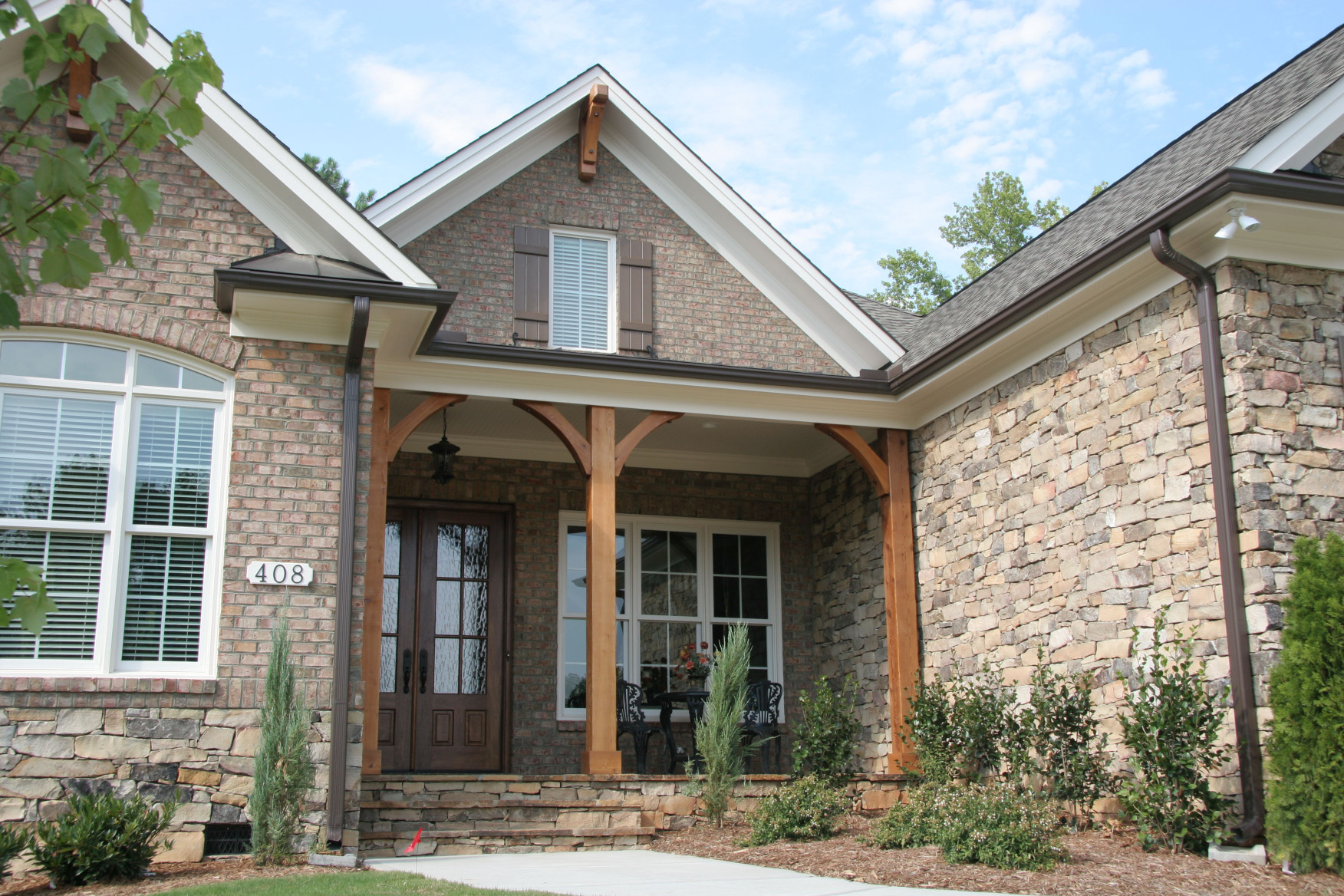 Our western red cedar post kit with brackets adds elegance to this home's front entry.