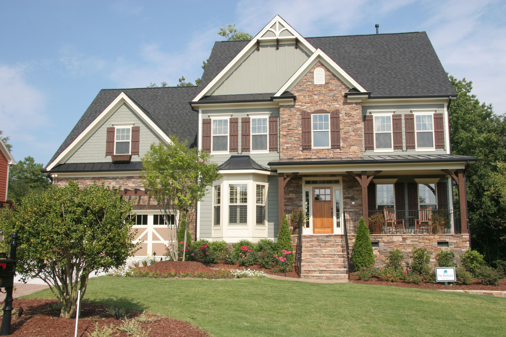 Gable Brackets, Braces, Cedar Shutters, and timber porch kit define this craftman style home