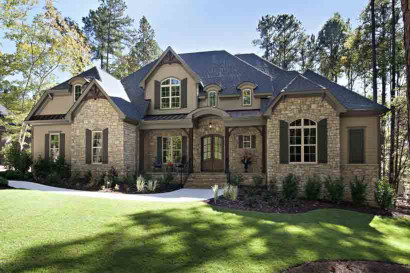 The wood braces, gable brackets, and wood posts add an Old World element to this home.