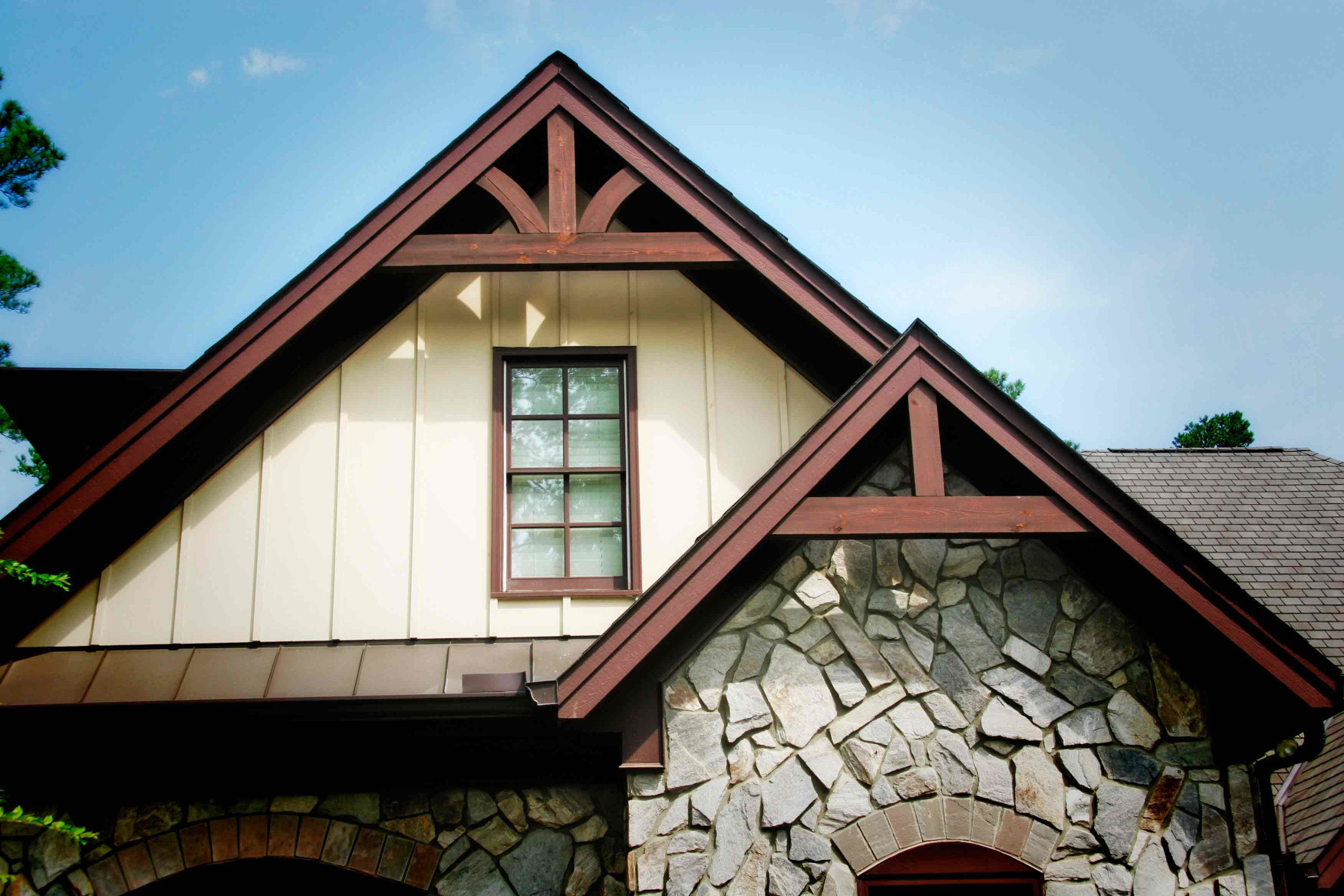 The wood gable brackets on this home are complementary to themselves and the appeal of the home.