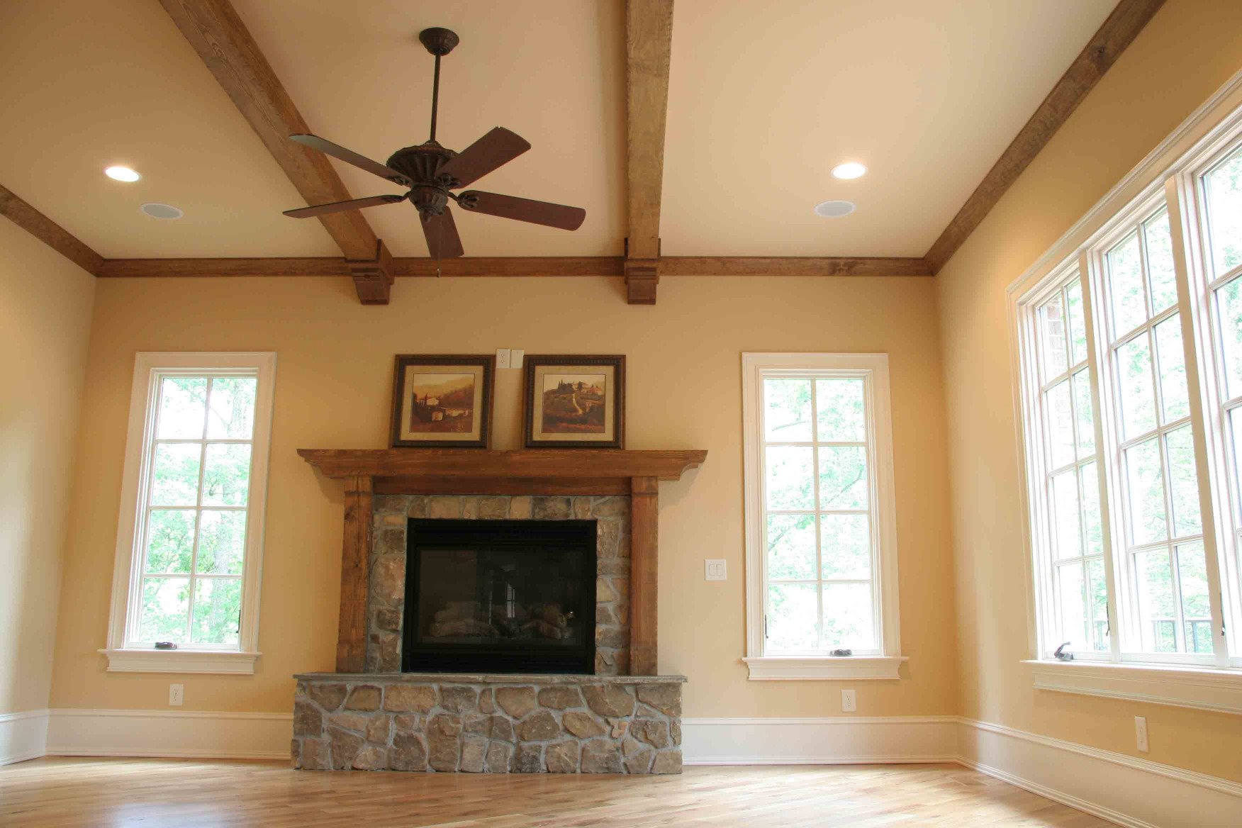 The wood beams, wood mantle with legs, and wood corbels are elegant in this room.
