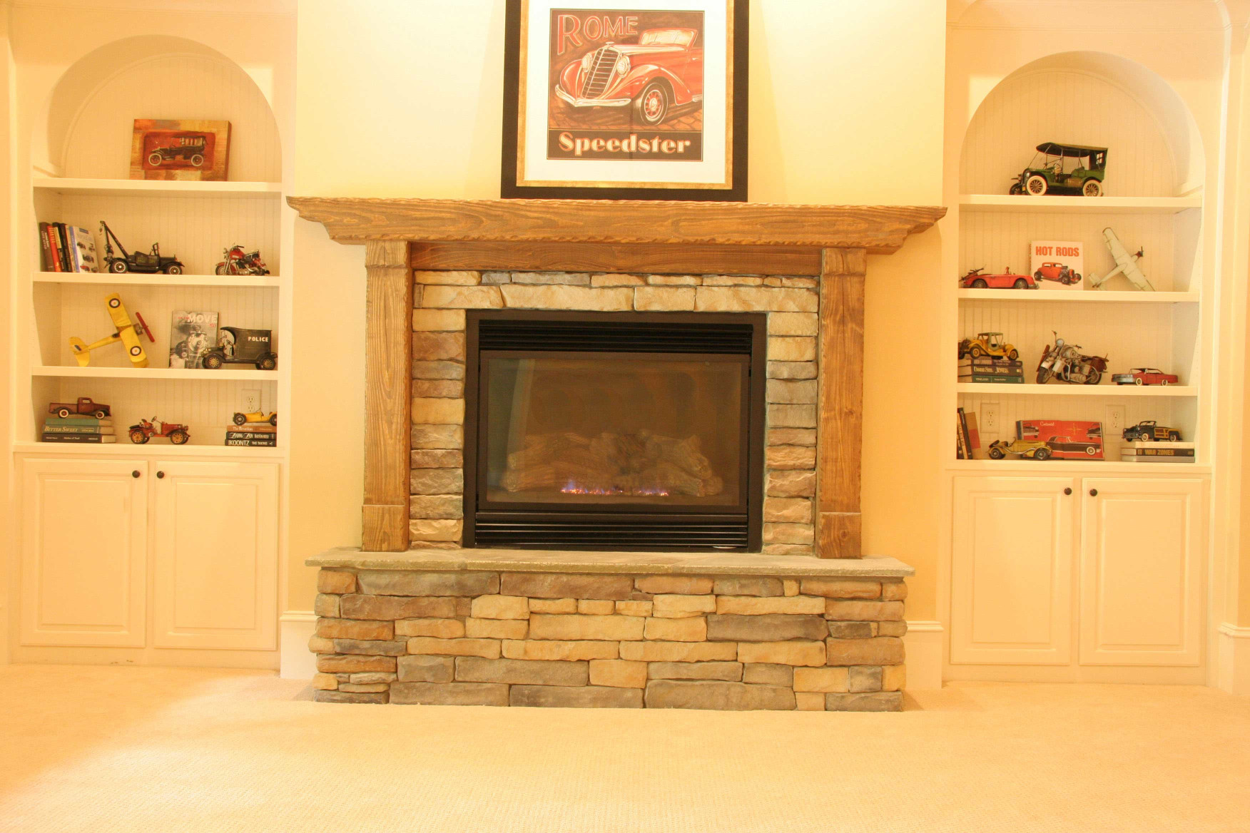 The wood mantle with legs is a perfect fit in this home.