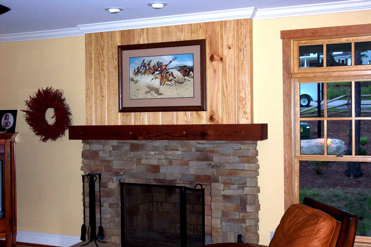 This wood mantle fits perfectly in this rustic style home.