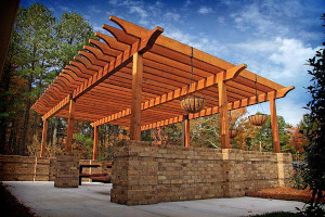 This wood pergola is a great way to add shade and appeal to this outdoor living space.