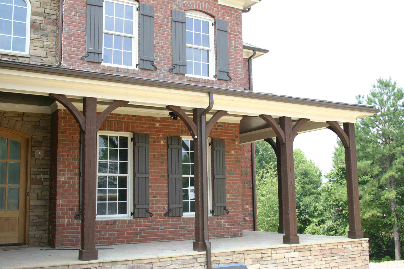 The wood braces and wood posts create our Standard Porch Kit.