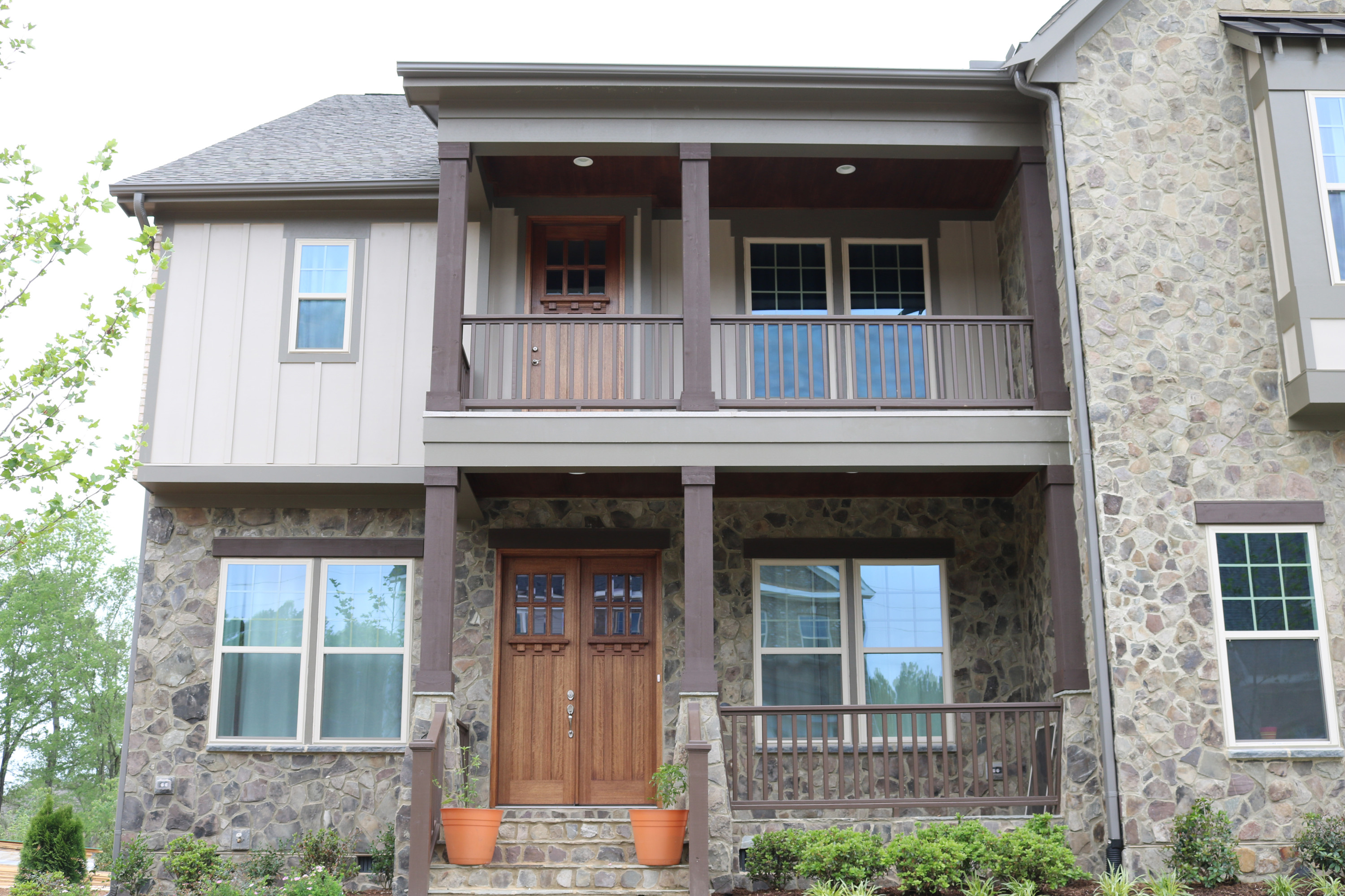 These wood post wraps and capital wraps work well with the architectural design of this home.