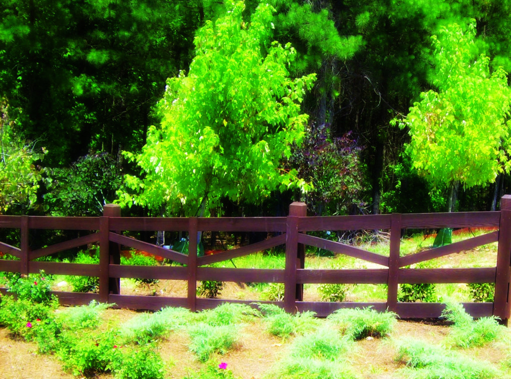 This wood beam and wood board fence looks great in this subdivision.
