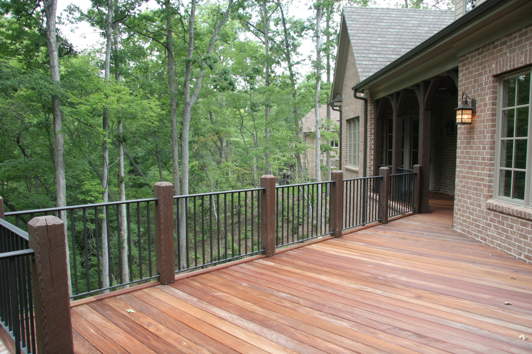 The wood railing posts on this porch have historical textures.
